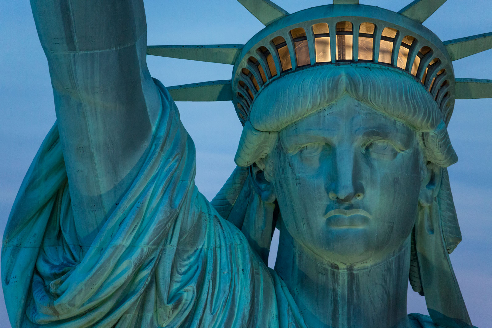The Statue of Liberty in New York city on an early summer morning.