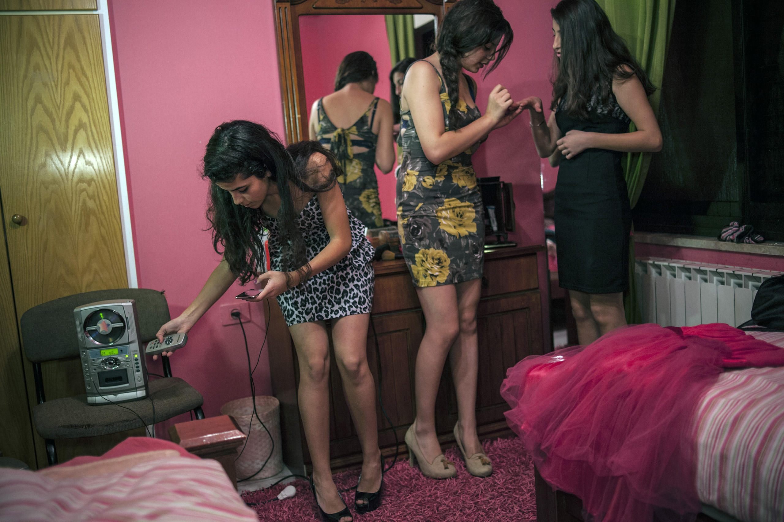 Teenage girls try on dresses for an upcoming dance. Ramallah.