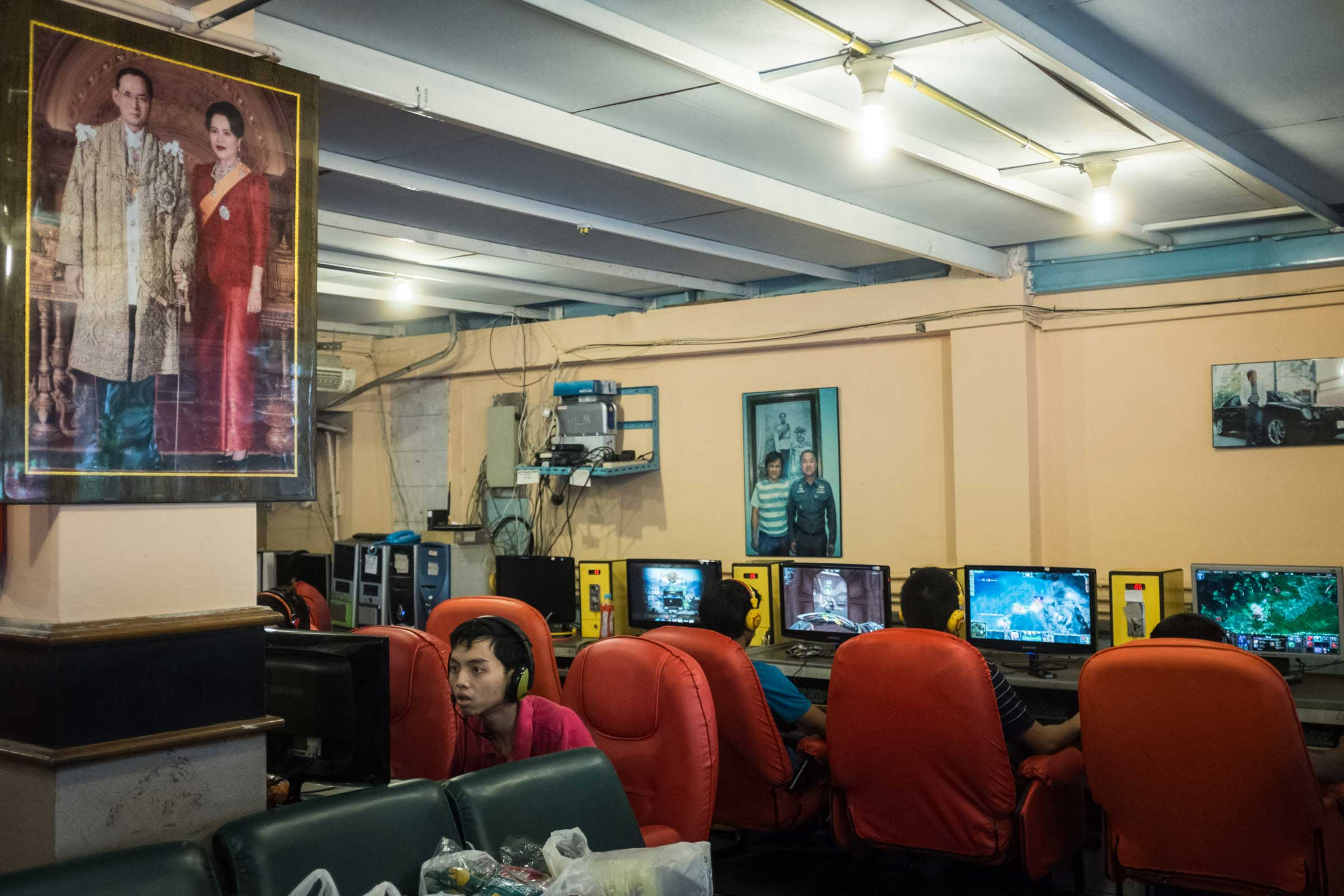 A picture of King Bhumibol and Queen Sirikit hangs in a gaming cafe in Bangkok,  Dec. 2014.