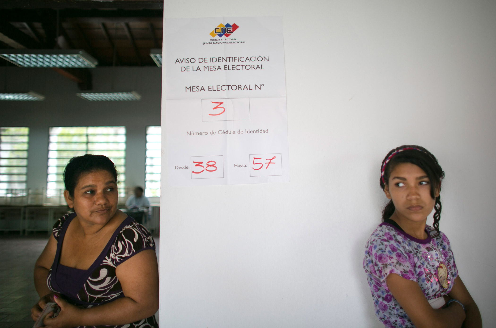 Voters wait to vote at a poll station during ruling party primary elections in Caracas, Venezuela, on June 28, 2015.