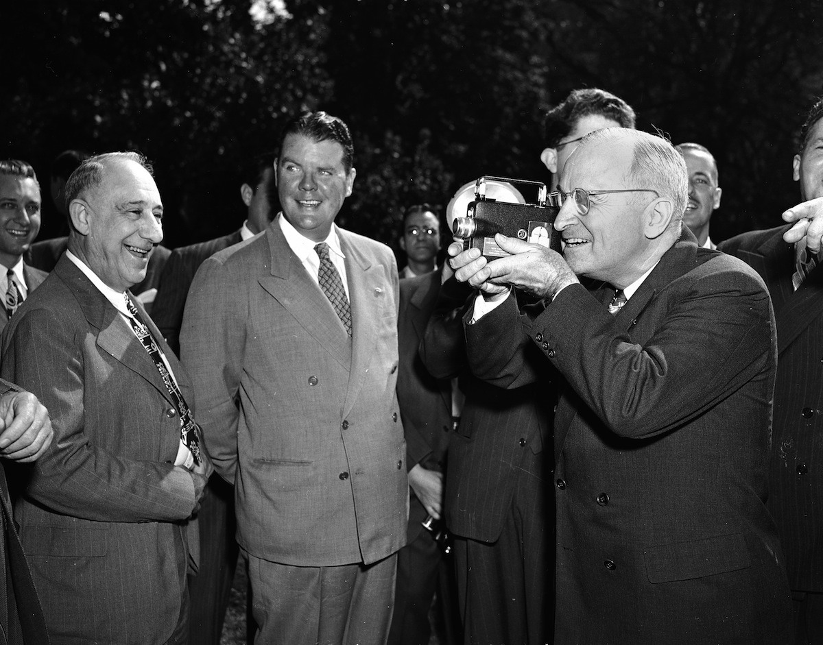 President Harry Truman operates a movie camera during a picture-taking session on the south grounds of the White House, Oct. 5, 1947.