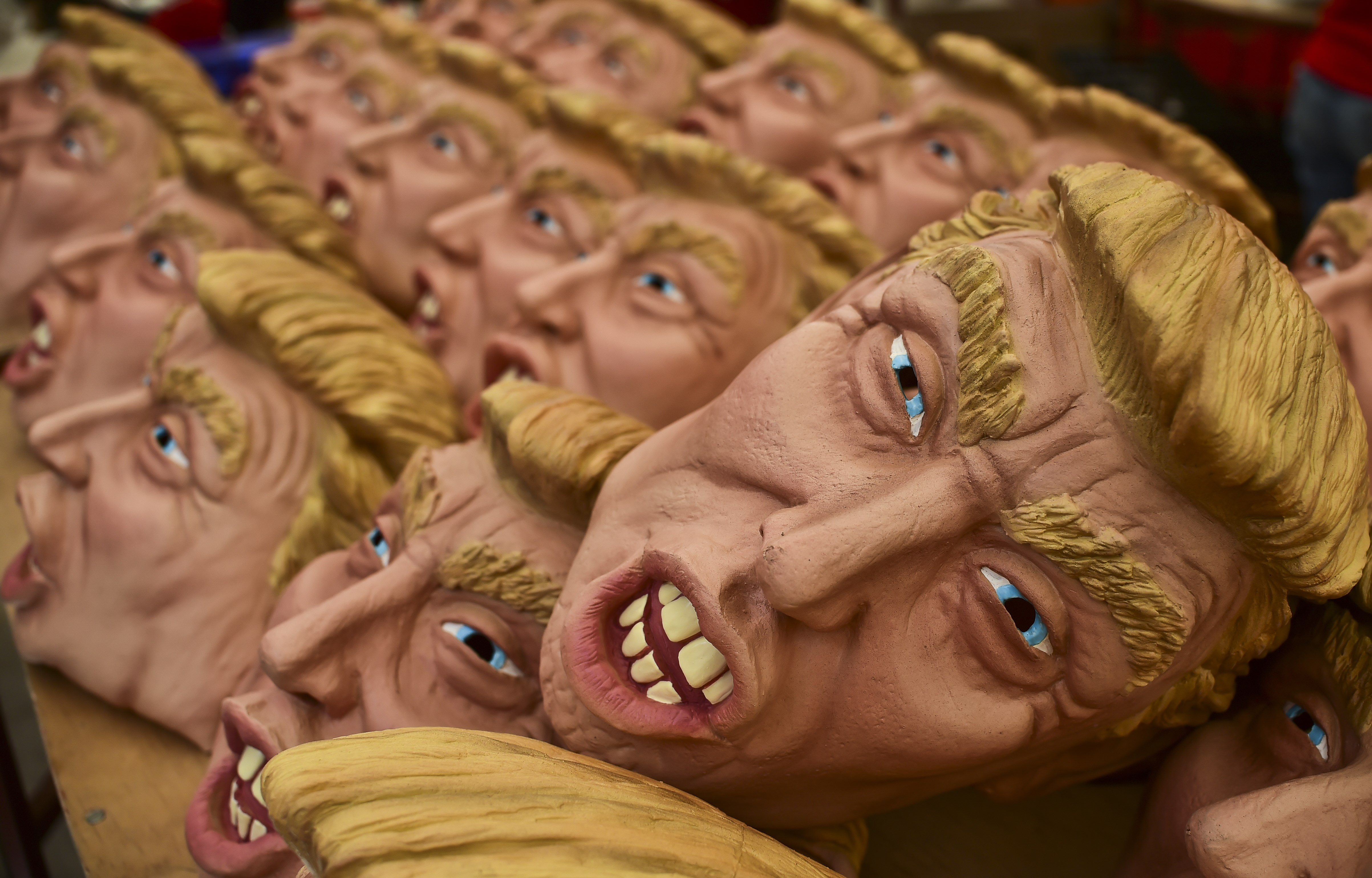 Masks representing Republican presidential candidate Donald Trump are pictured in a factory of costumes and masks, on Oct. 16, 2015, in Jiutepec, Morelos State.