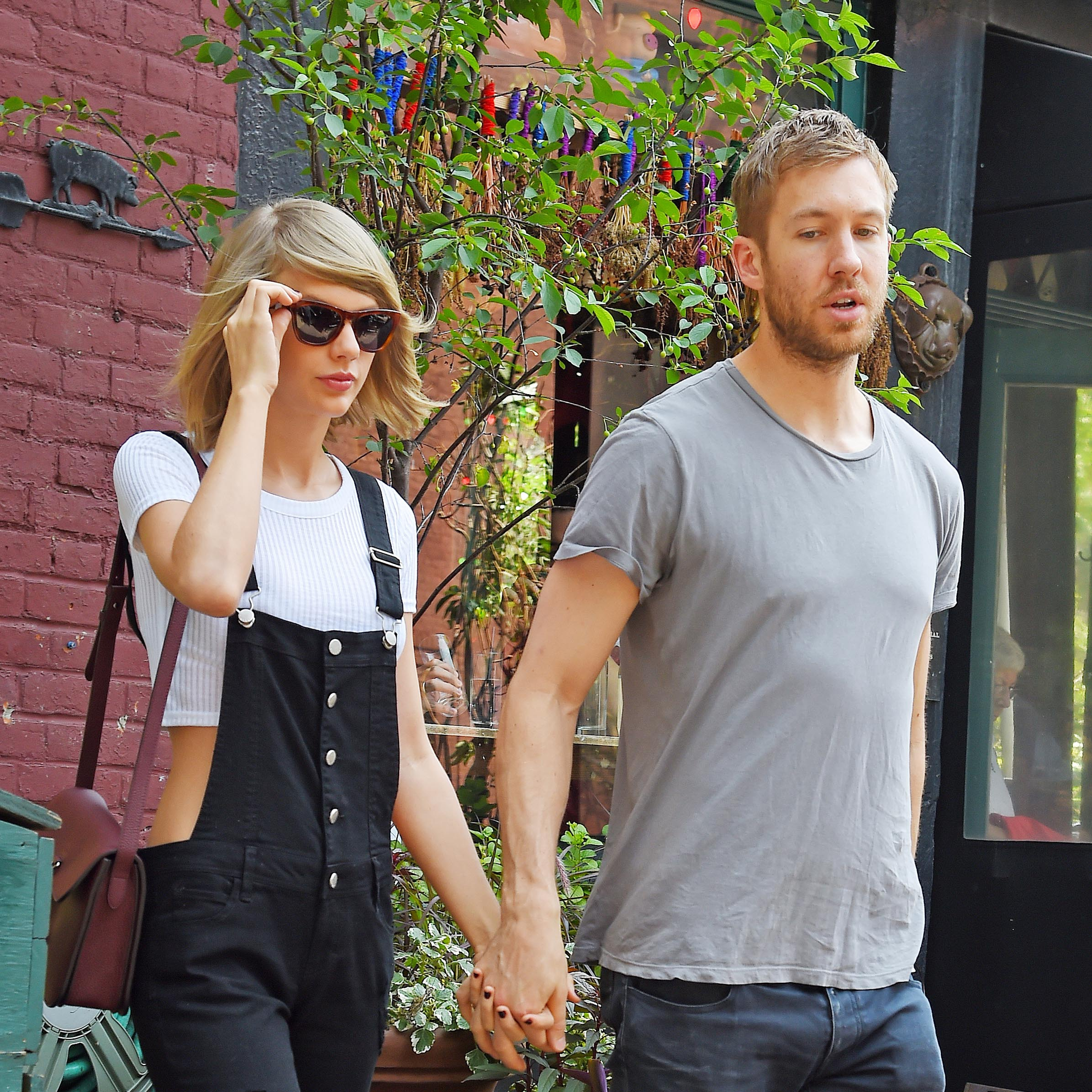 Taylor Swift and Calvin Harris get lunch at the Spotted Pig on May 28, 2015 in New York, New York.