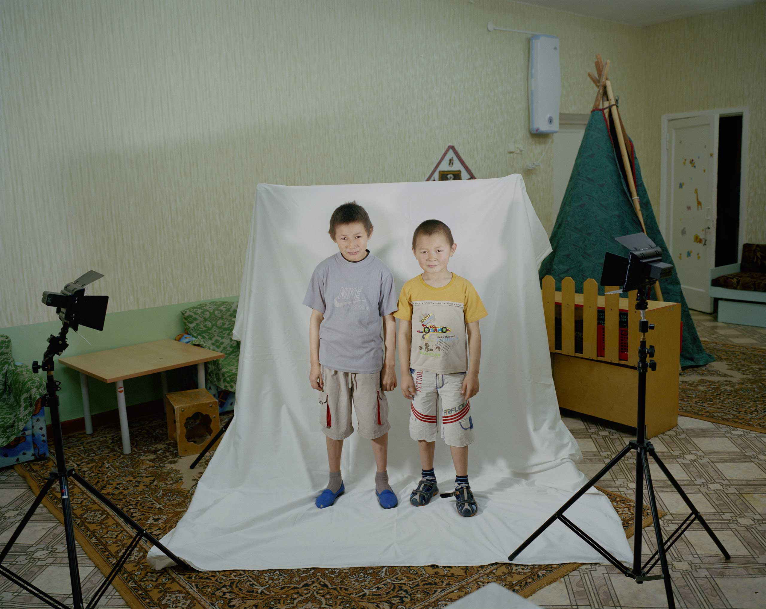 Two boys pose for a portrait.