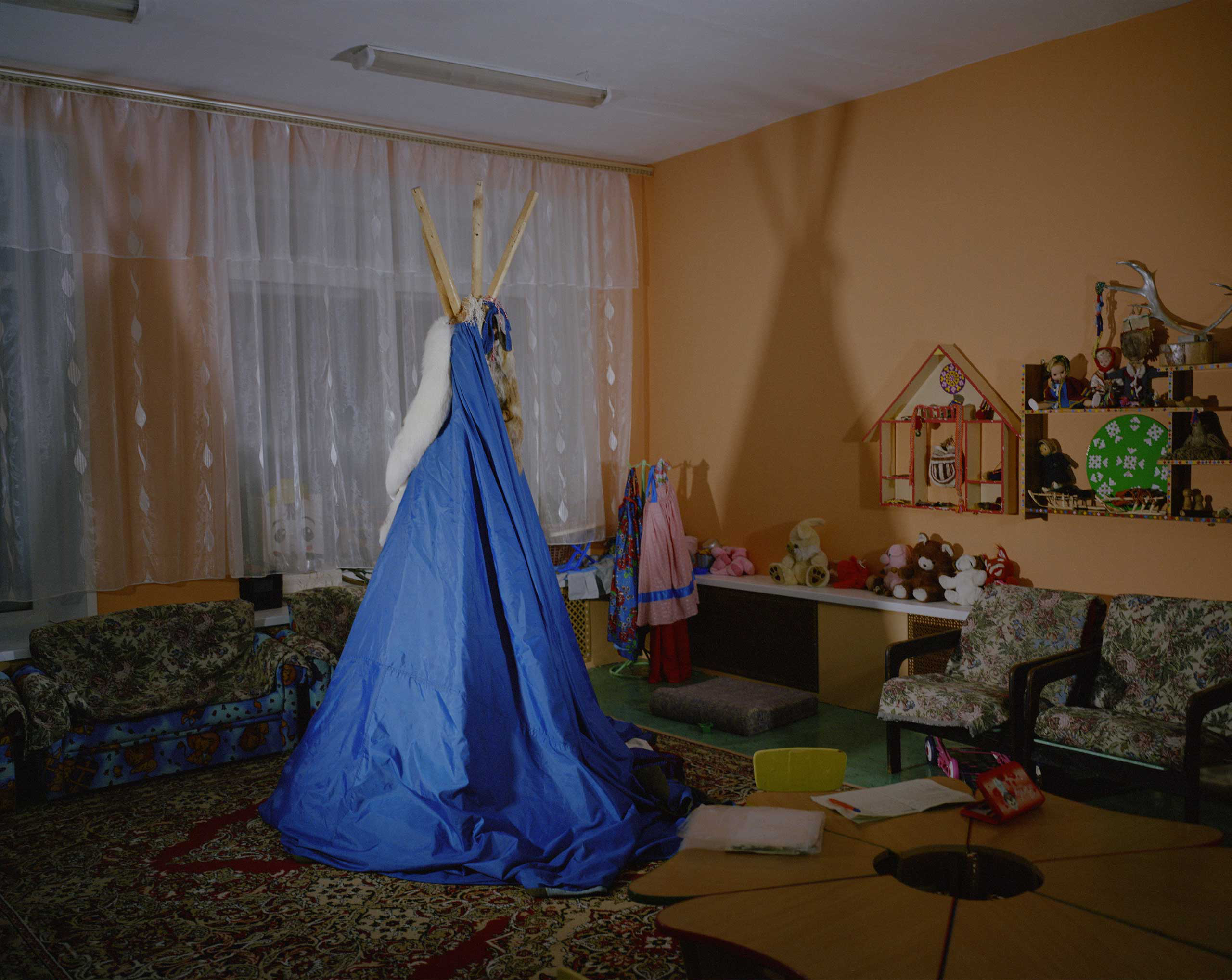 A chum is placed in the playing room. A chum is a traditional mobile tent used by the Nenets people.
