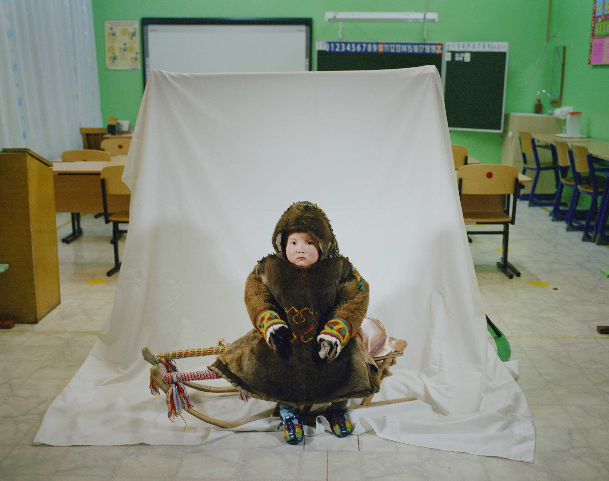 A student on the sledge in the traditional costume.