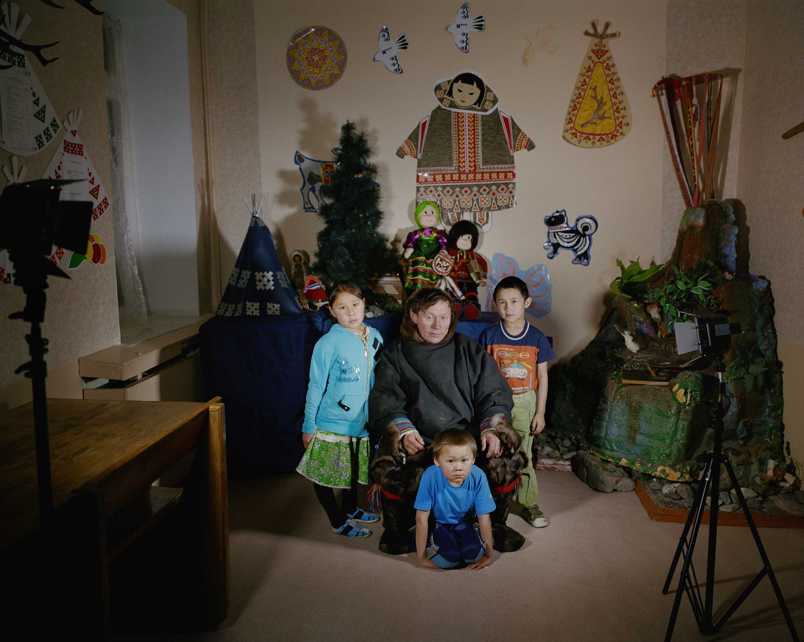 Portrait of students with their family member, who visited the boarding school to see the children in Vorkuta, Russia.