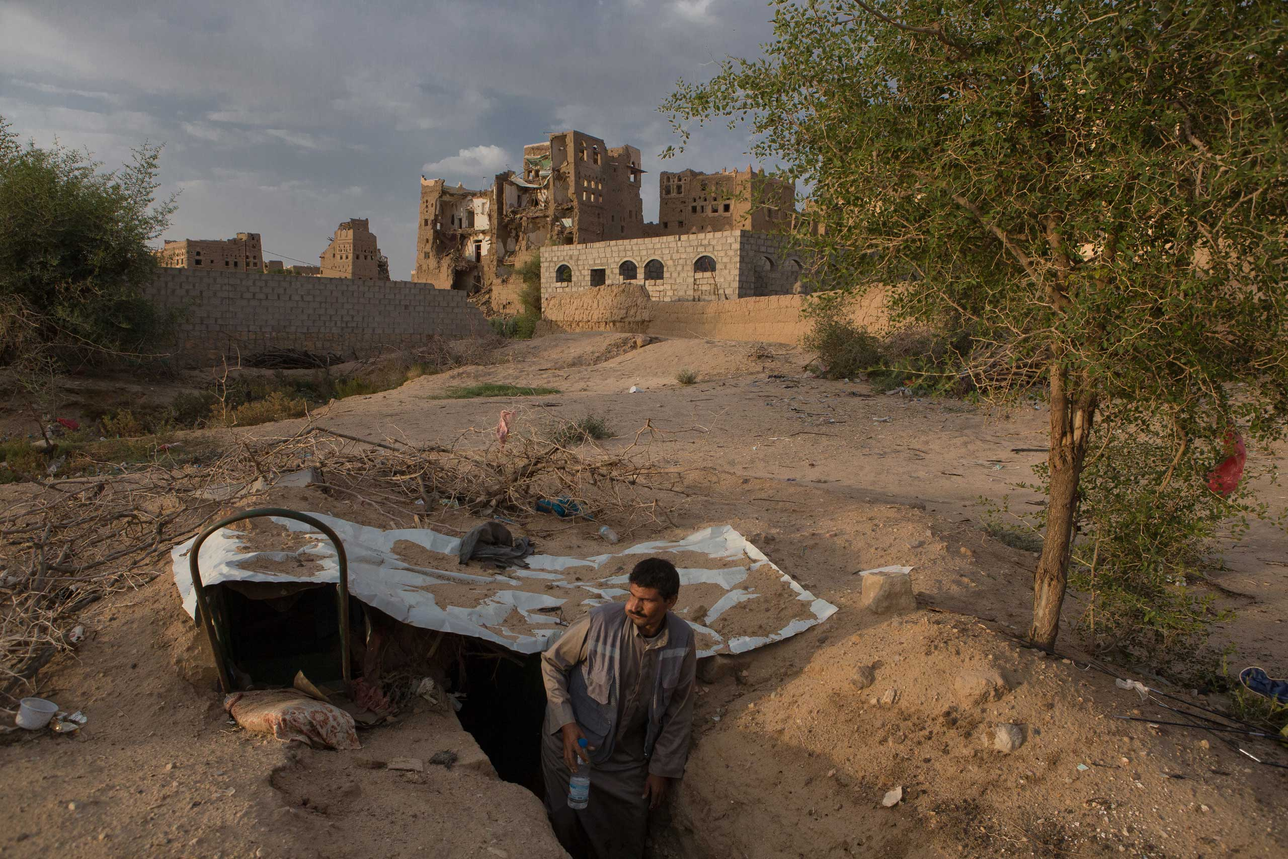 A man stands in a                               shelter dug in the                               ground in Rahban,                               on the outskirts                               of Saada City, the Houthi stronghold where the rebel movement was founded  in northern Yemen, Aug. 26, 2015.