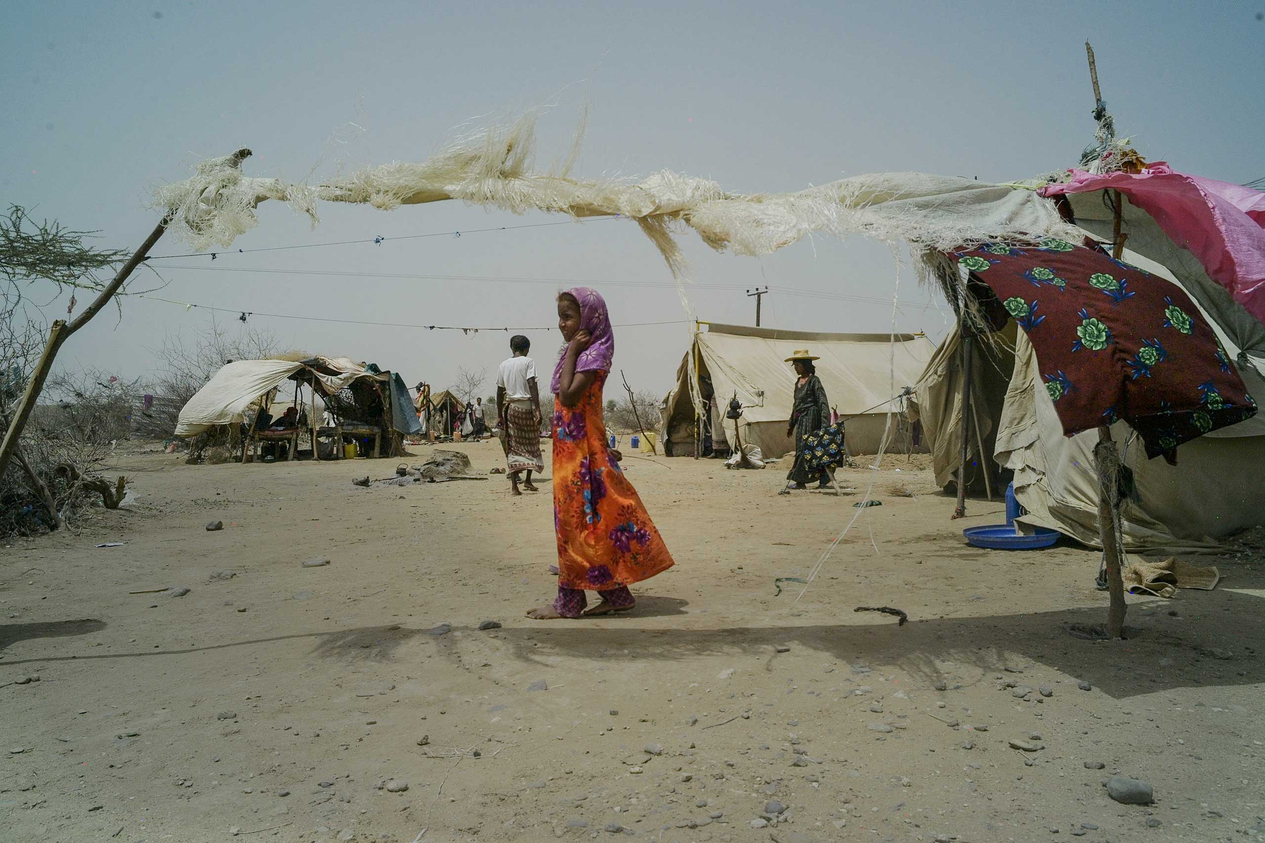 A young girl at the Al Majoura camp for displaced people in northern Yemen which is undergoing a severe food and humanitarian crisis since airstrikes began in the Spring, Aug. 2015.
