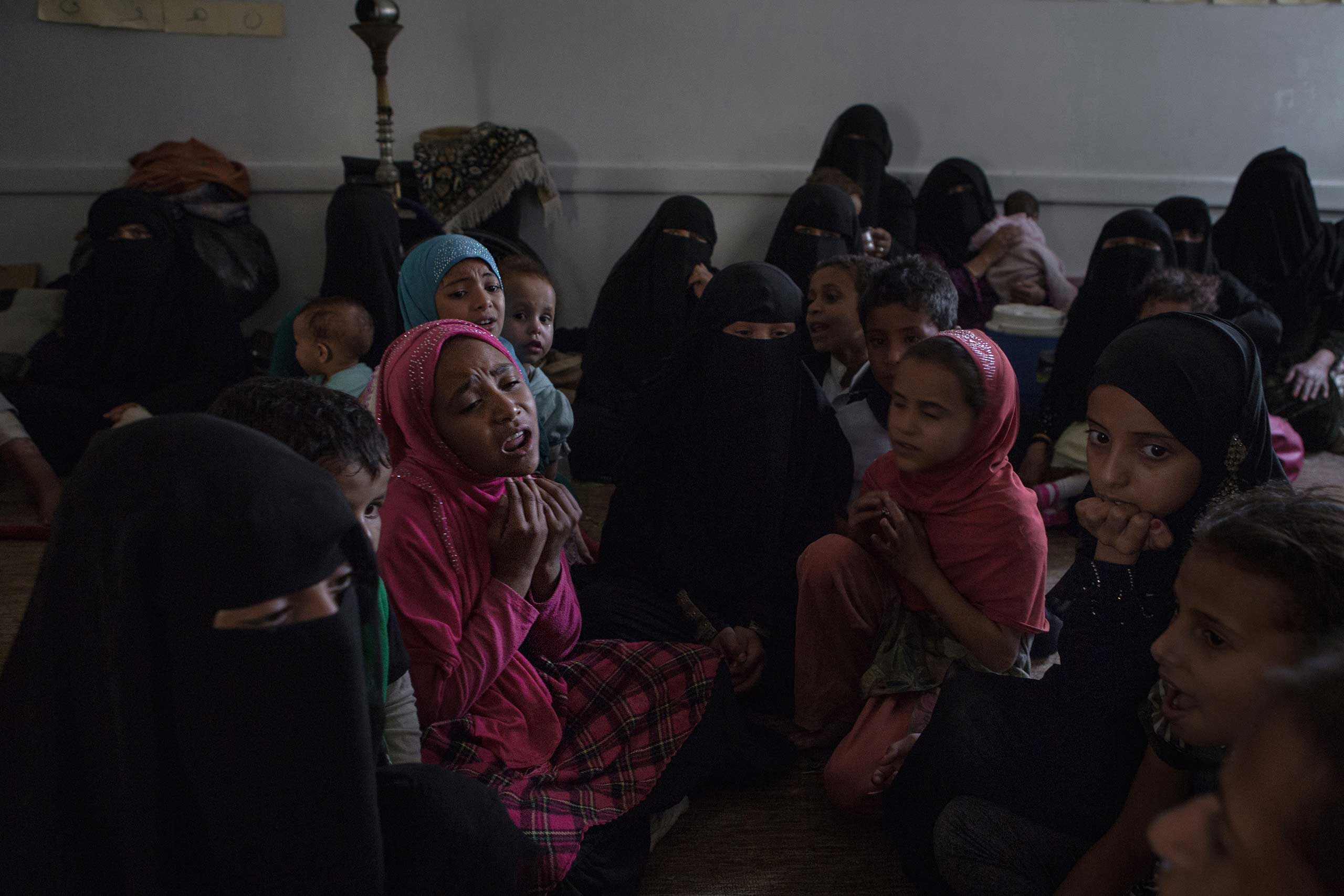 Children displaced  from fighting in Saada in northern Yemen sing songs about their homeland. They have found refuge in a school in the capital city of Sanaa, Aug. 23, 2015.