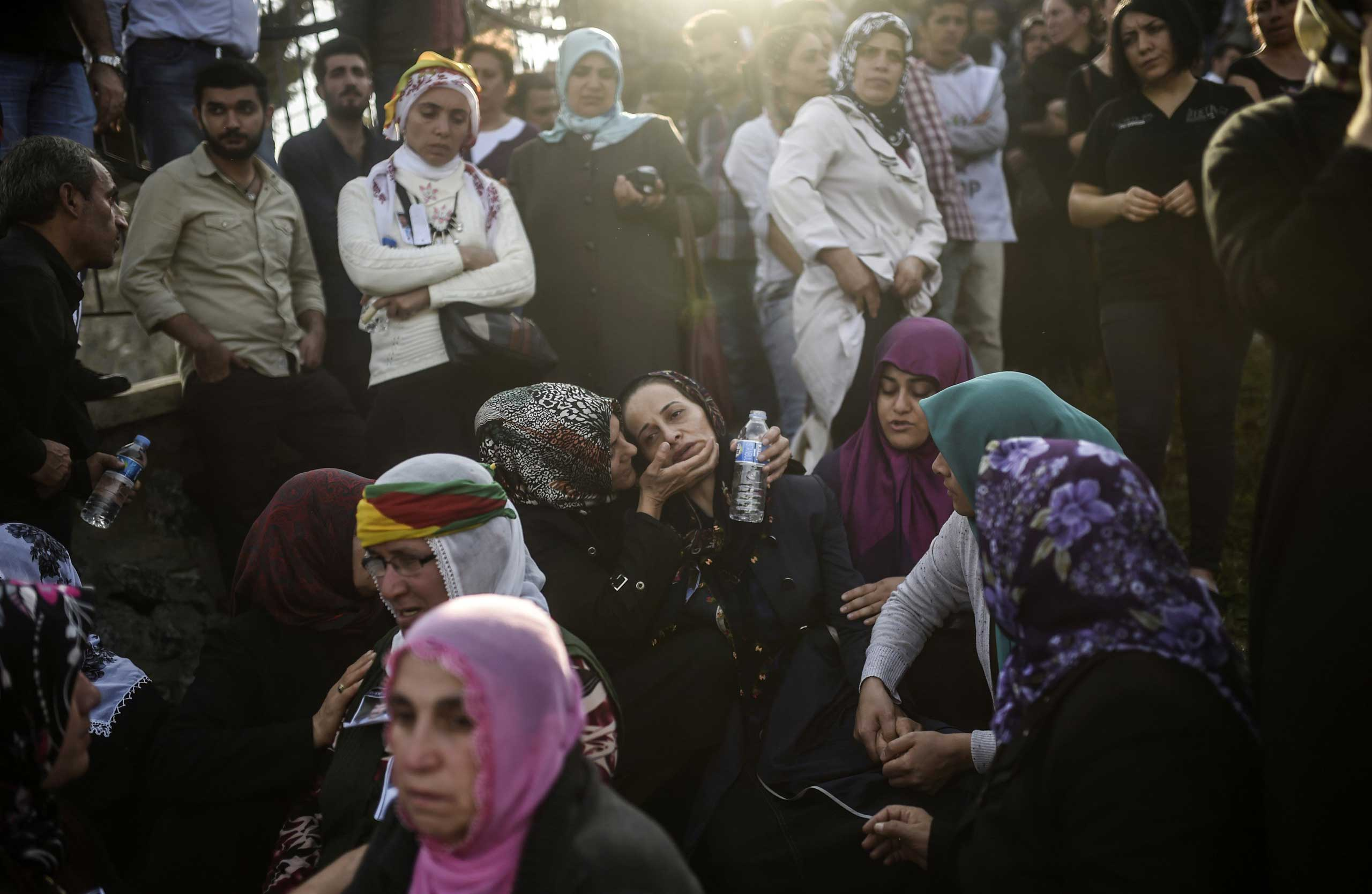 Relatives mourn near the grave of a victim of the twin bombings in Ankara, during the funeral in Istanbul on Oct. 12, 2015.