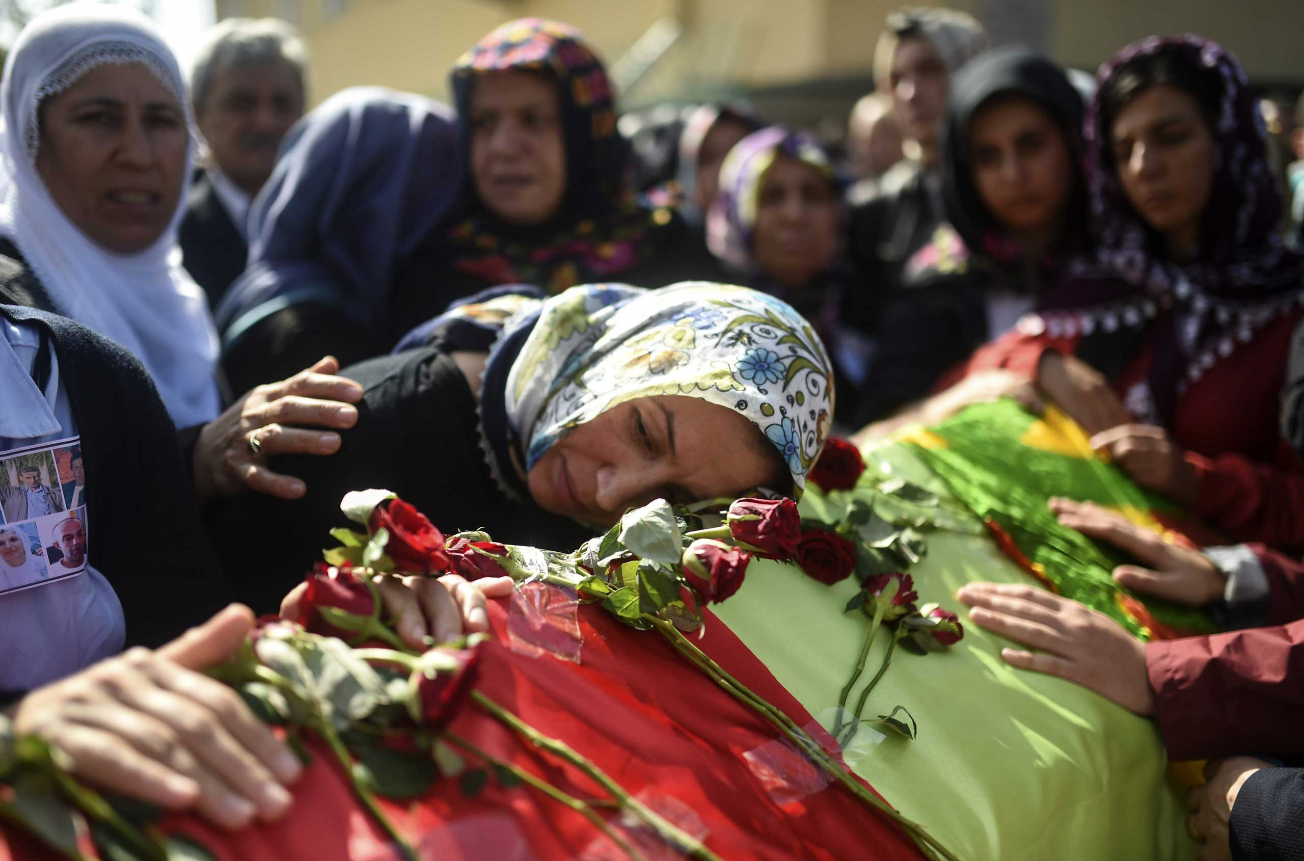 Relatives mourn near the coffin of a victim of the twin bombings in Ankara, during the funeral in Istanbul on Oct. 12, 2015.