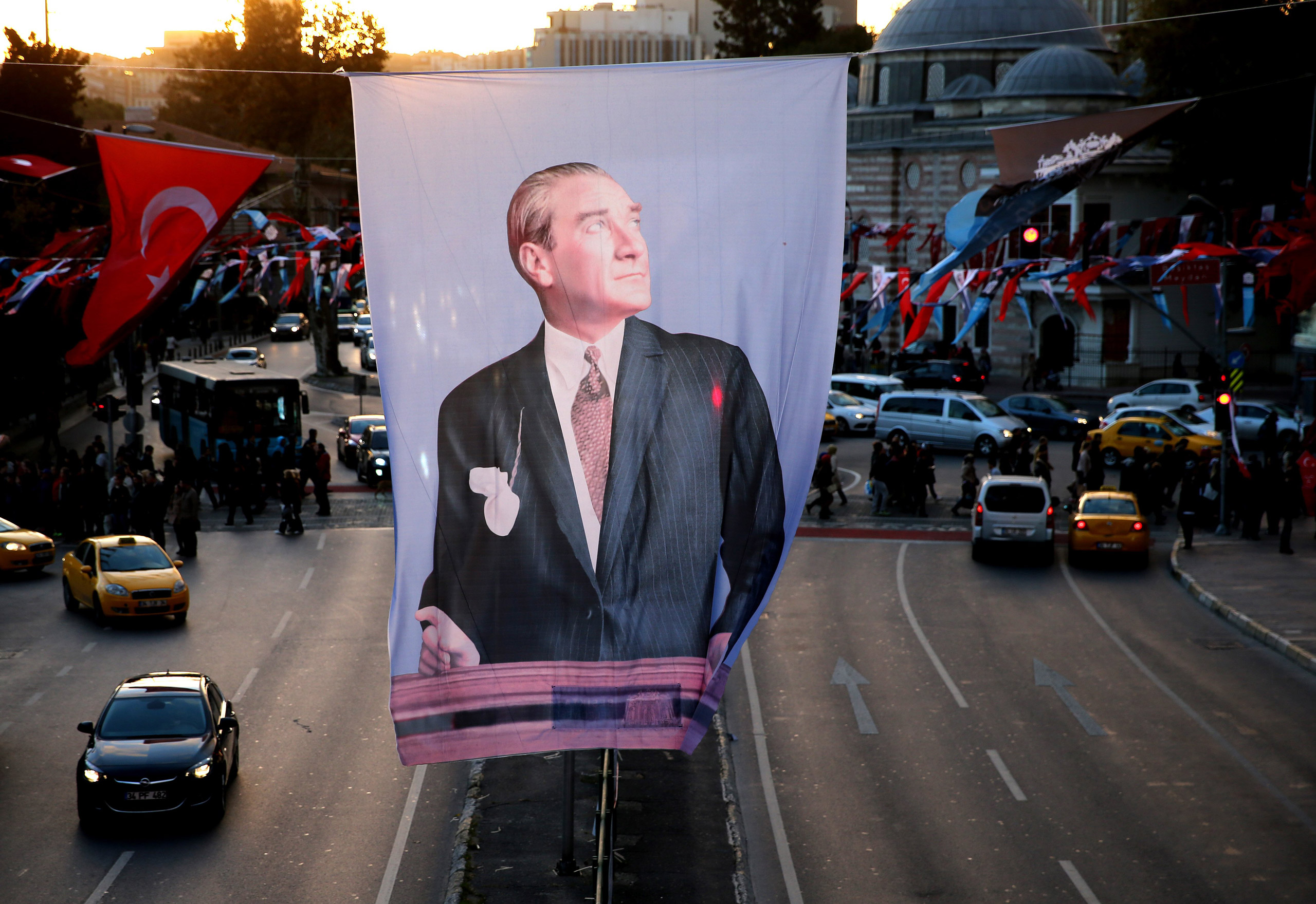 A portrait flag of the Turkish Republic founder Mustafa Kemal Ataturk hangs in Besiktas square in Istanbul, on Oct. 31, 2015.