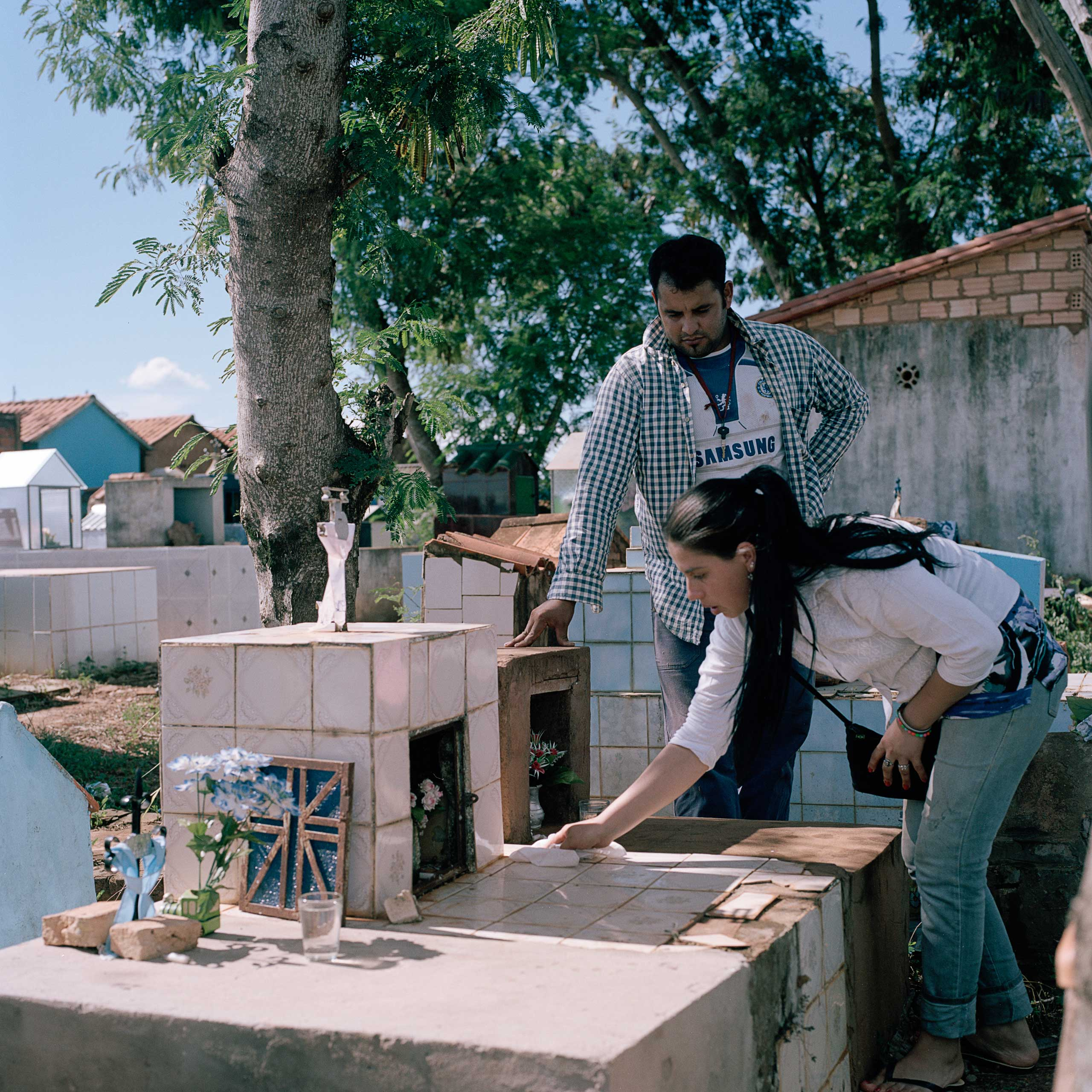 Perla da Silva, 26 and her husband José Domingo, 28, clean the small mausoleum where their sons are buried. She says shortly after the neighboring soy field began fumigating their crops, she started to feel sick and suffered a miscarriage, eight months into her pregnancy. A year later, she got pregnant again but their newborn son started to have heart problems at the age of 4 months and died shortly after. She believes the events are linked to her exposure to pesticides while pregnant.