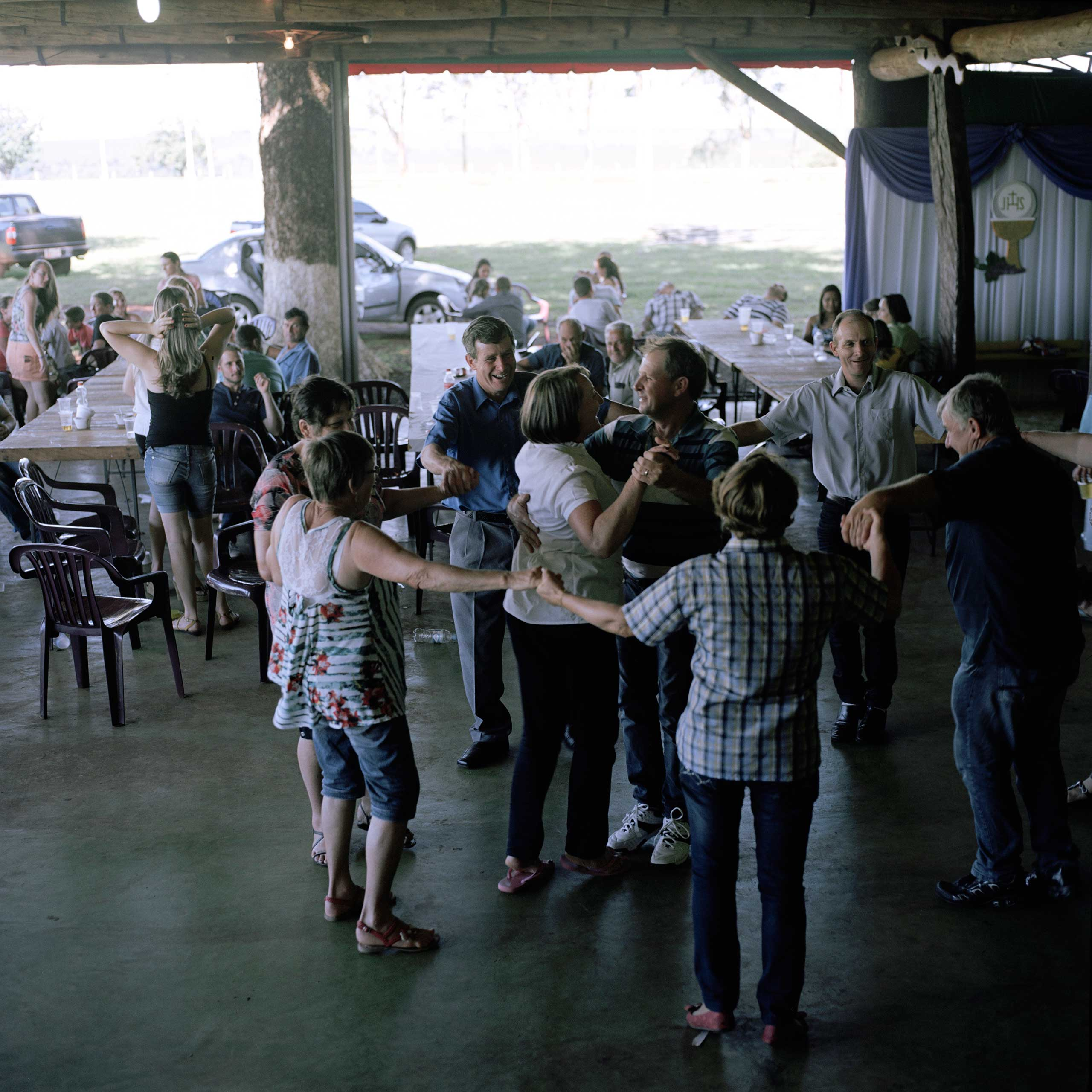The workers at Kolbeck's plantation celebrate one of their birthdays and first communion with a big barbecue in Iruña. The plantation is run by just seven workers, all of Brazilian origin, who live with their families together inside the plantation.