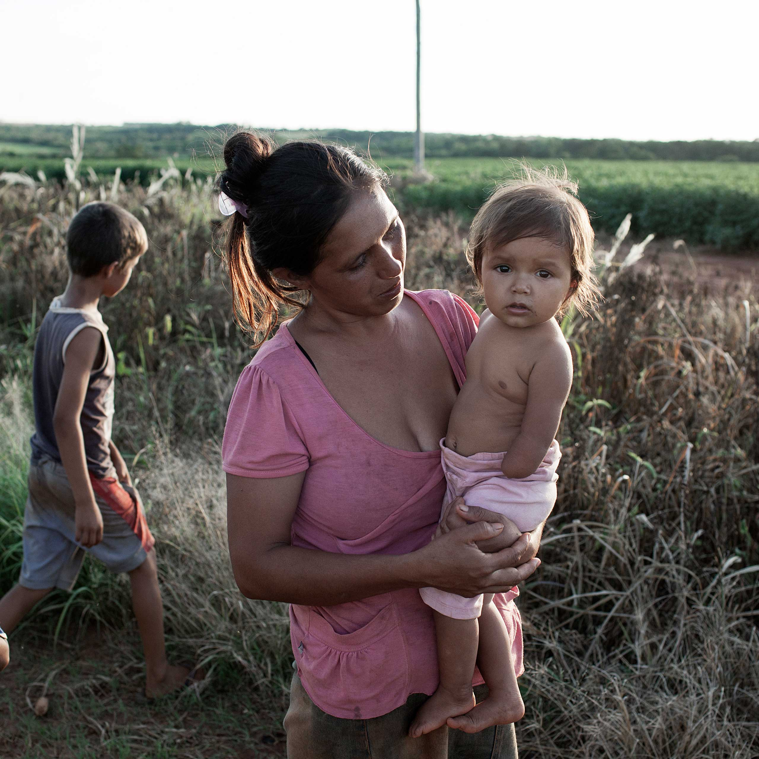 Magdalena Prete, 30, with her daughter Andrea Natalia, who was born without an arm. Prete believes this was due to exposure to pesticides while she was pregnant. The family lives in a highly impoverished area surrounded by soy fields. According to some doctors the number of congenital malformations has increased dramatically in the areas where soy is planted on a mass scale.