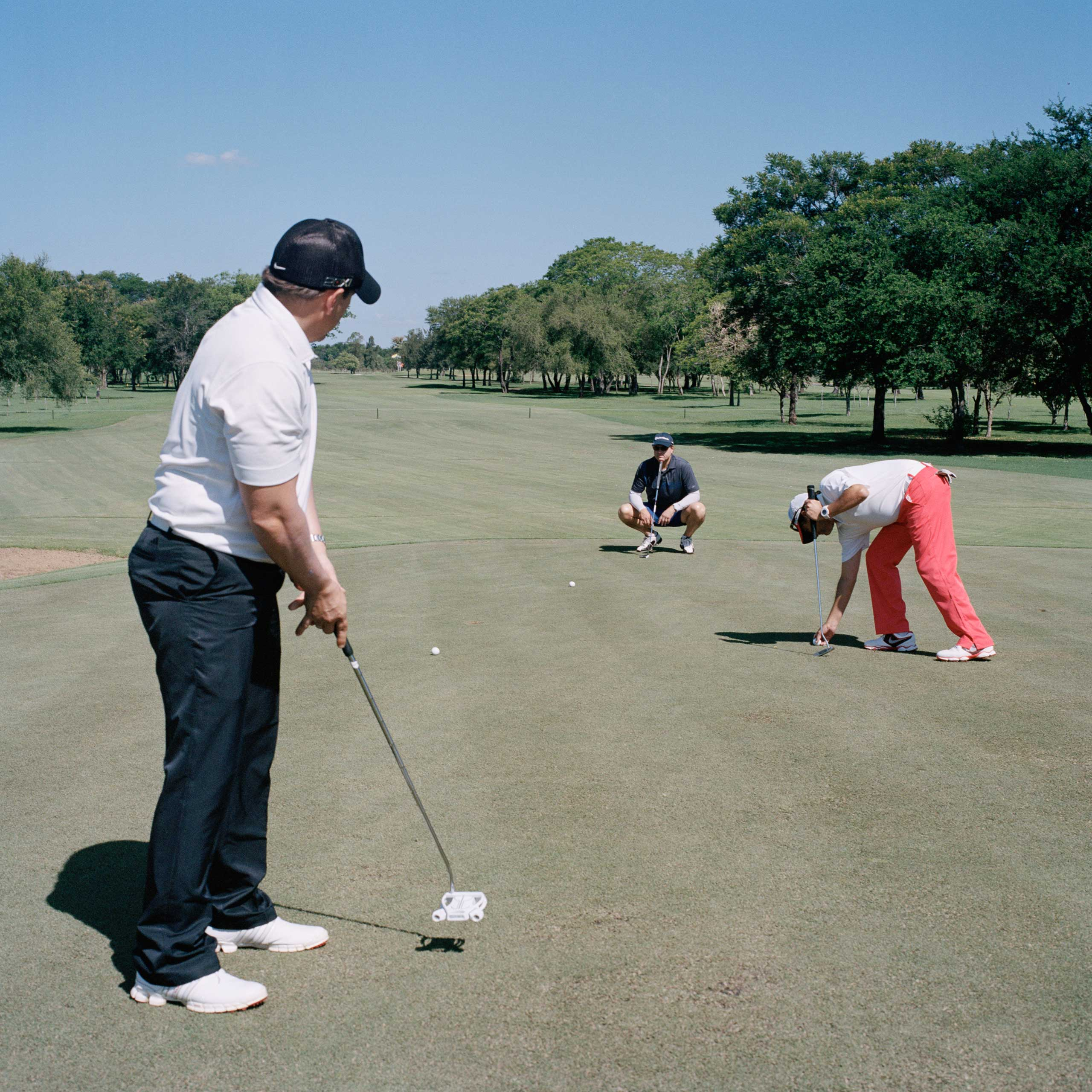 Members of the Club Centenario, the most exclusive club in Asunción, play golf during their weekly appointment. According to one of the workers, a vast majority of members are part of the country's agribusiness elite.