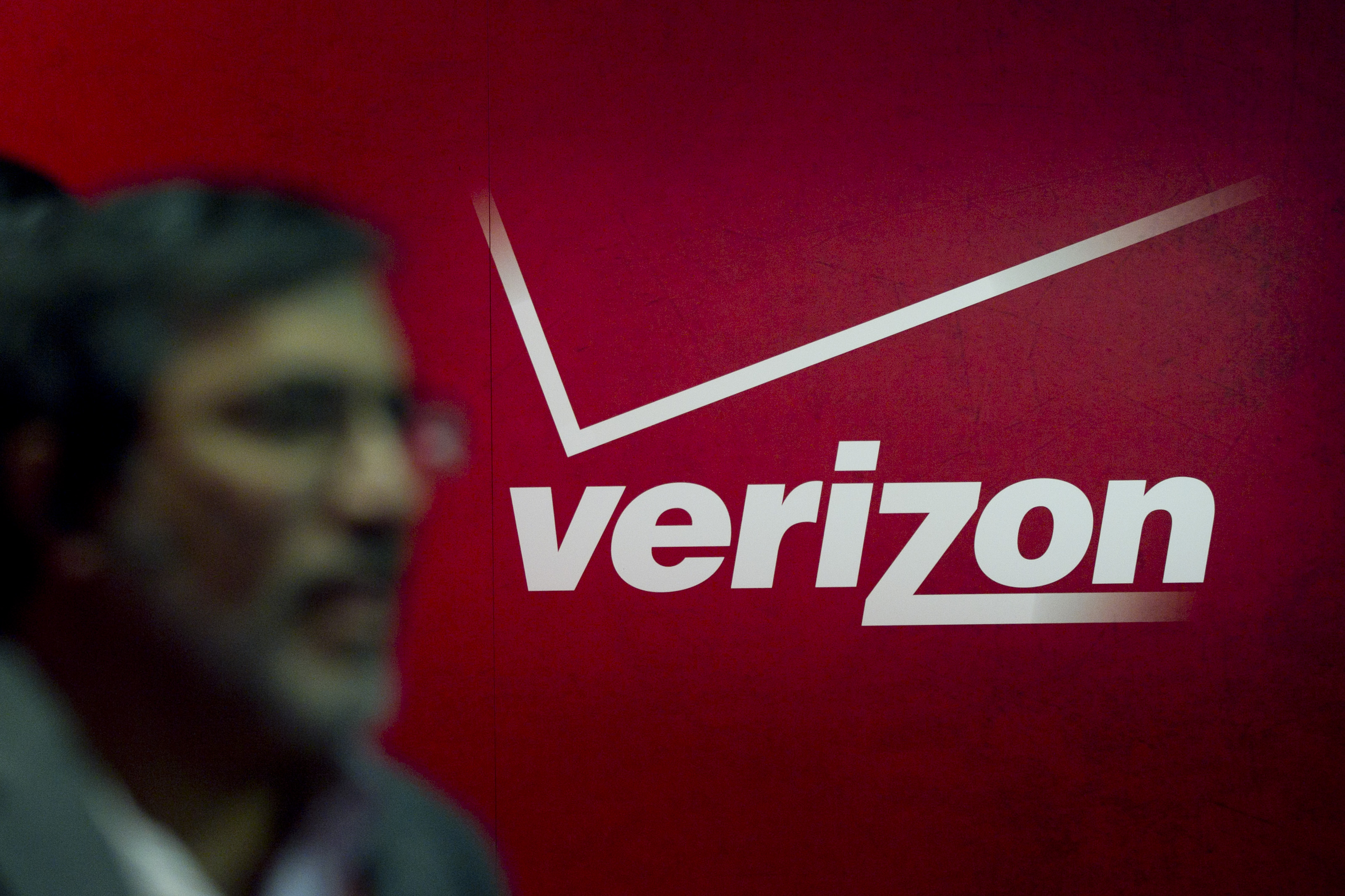The Verizon Communications Inc. logo at the International Consumer Electronics Show (CES) in Las Vegas on Jan. 12, 2012.