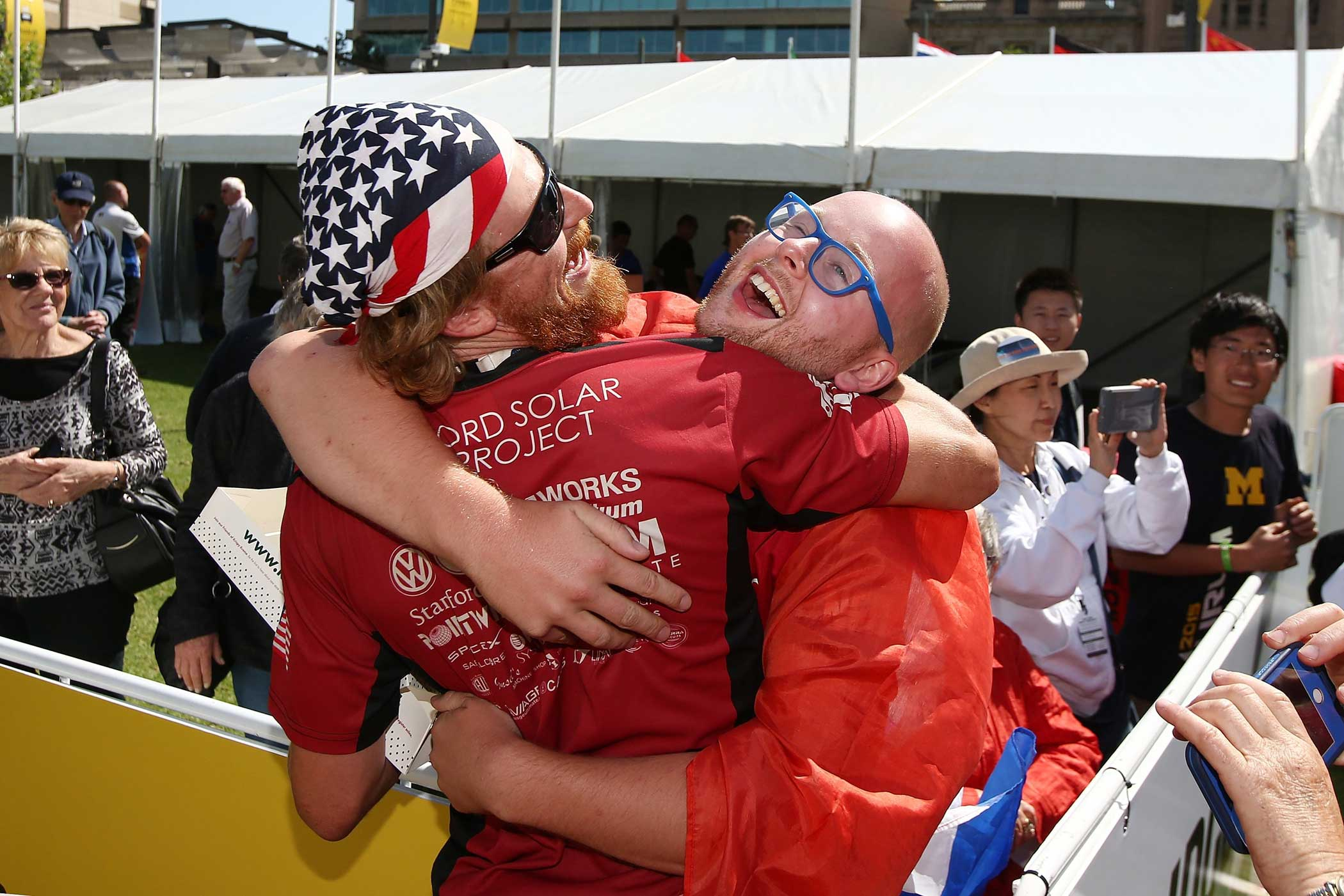 Members of the Stanford Solar Car Project team celebrate after finishing the race at Victoria Square in Adelaide, Australia on Oct. 22, 2015.