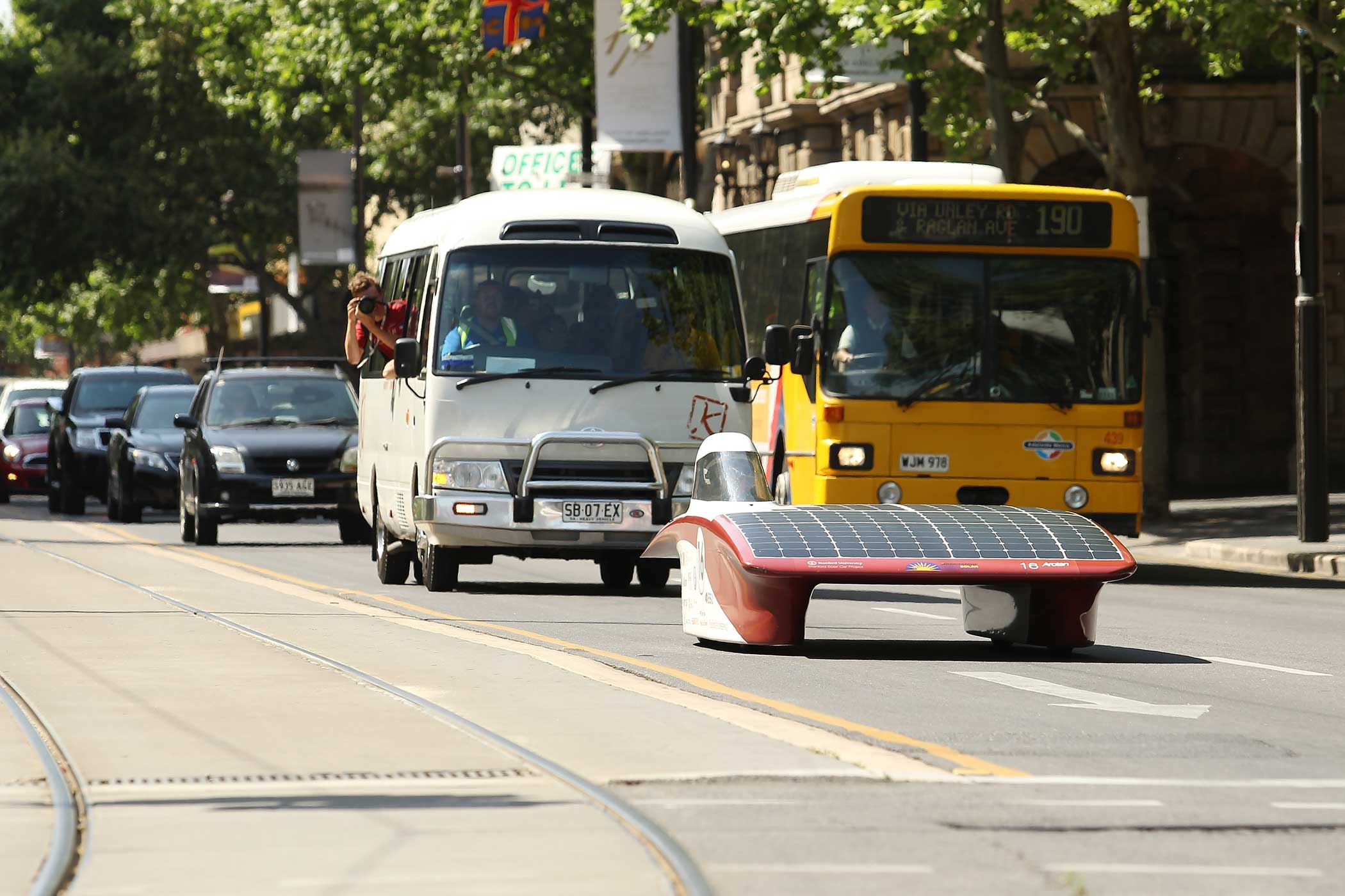 Members of the Stanford Solar Car Project team approach the finish line at Victoria Square, Adelaide, Australia on Oct. 22, 2015.