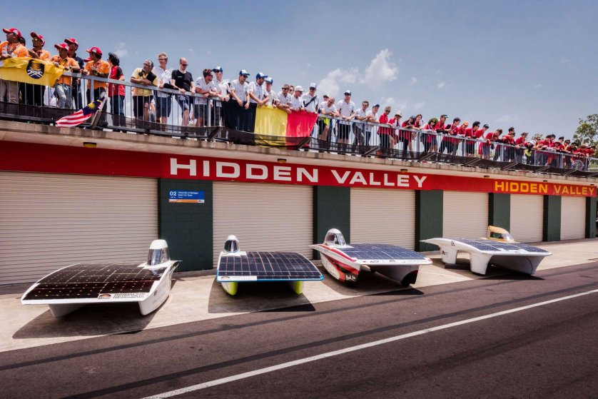 Punch Powertrain Solar Team shows team members posing above their cars after the qualification lap for the 2015 Bridgestone World Solar Challenge at Hidden Valley race track in Darwin on Oct. 18, 2015.
