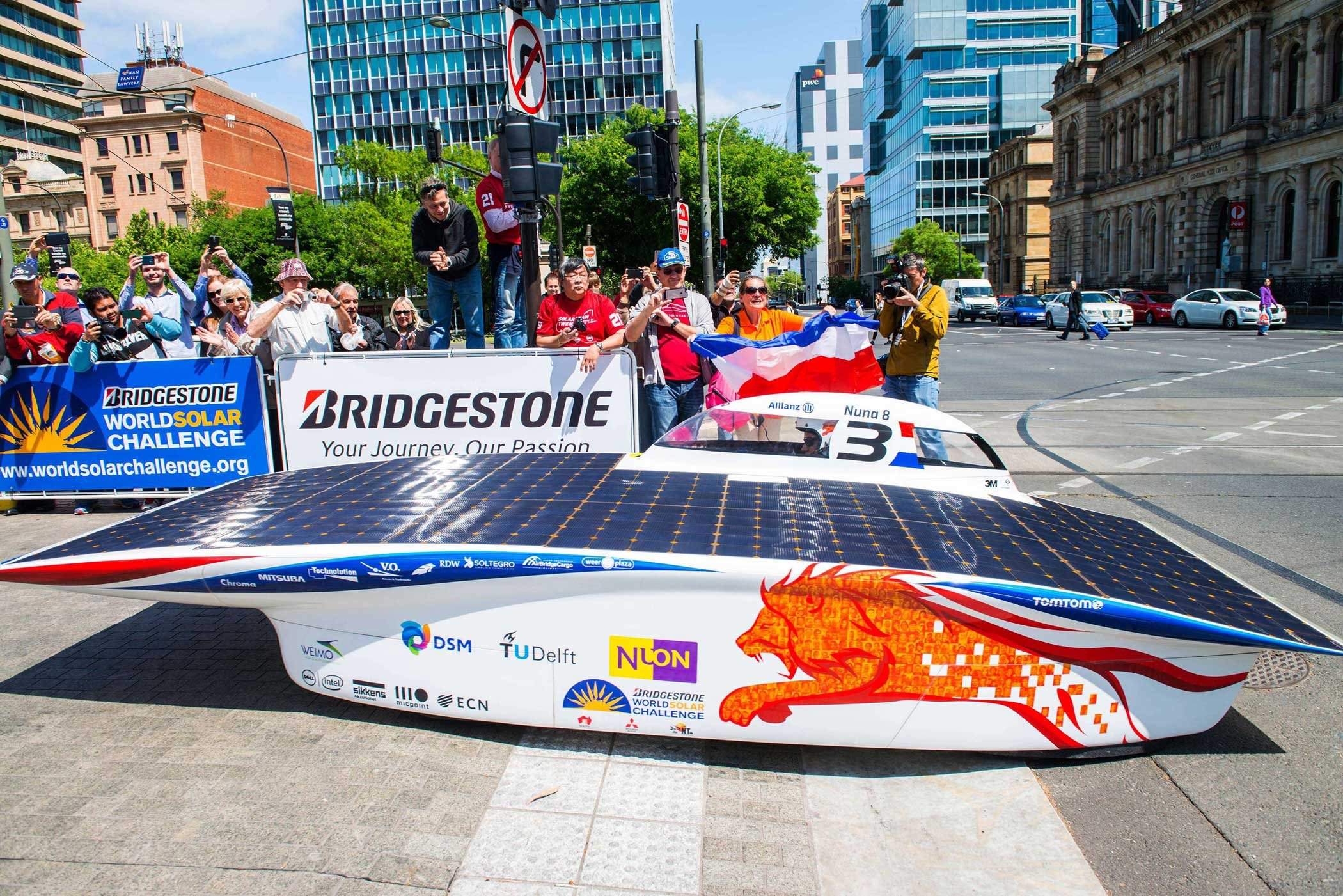 Car of the Dutch team Nuon Solar Team crosses the finish line to win the 2015 World Solar Challenge, in Adelaide on Oct. 22, 2015.
