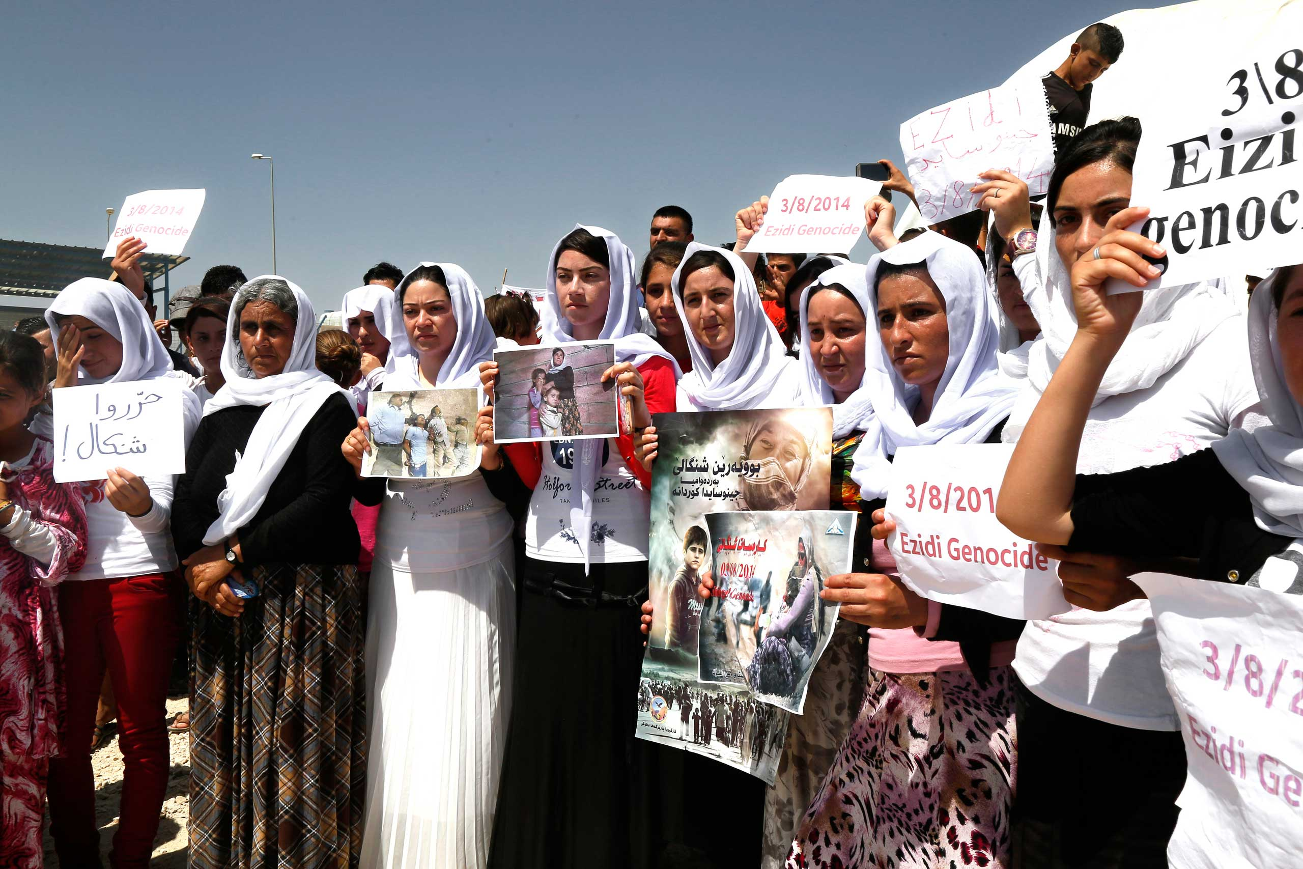 Yezidi women protest against ISIS in Dohuk, northern Iraq, on Aug. 3, 2015.