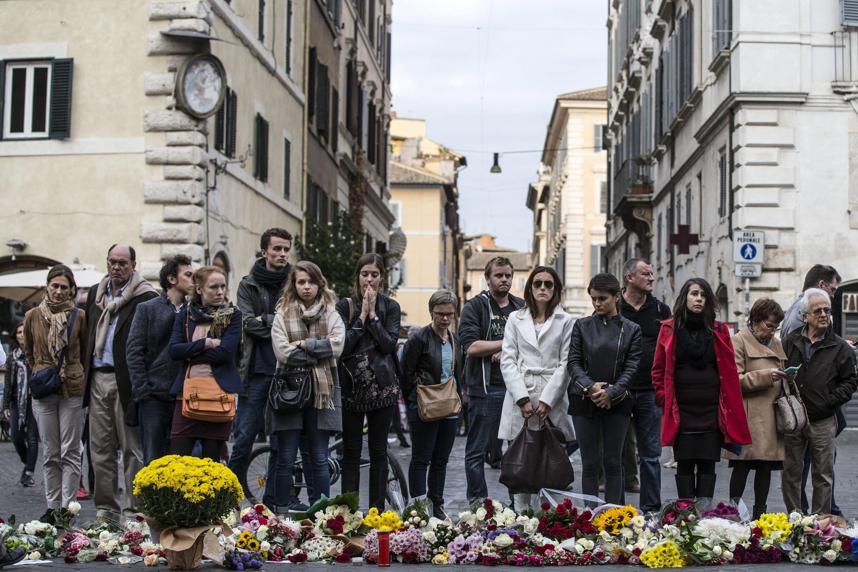 Flowers are laid in front of the French embassy in Rome on Nov. 14, 2015.