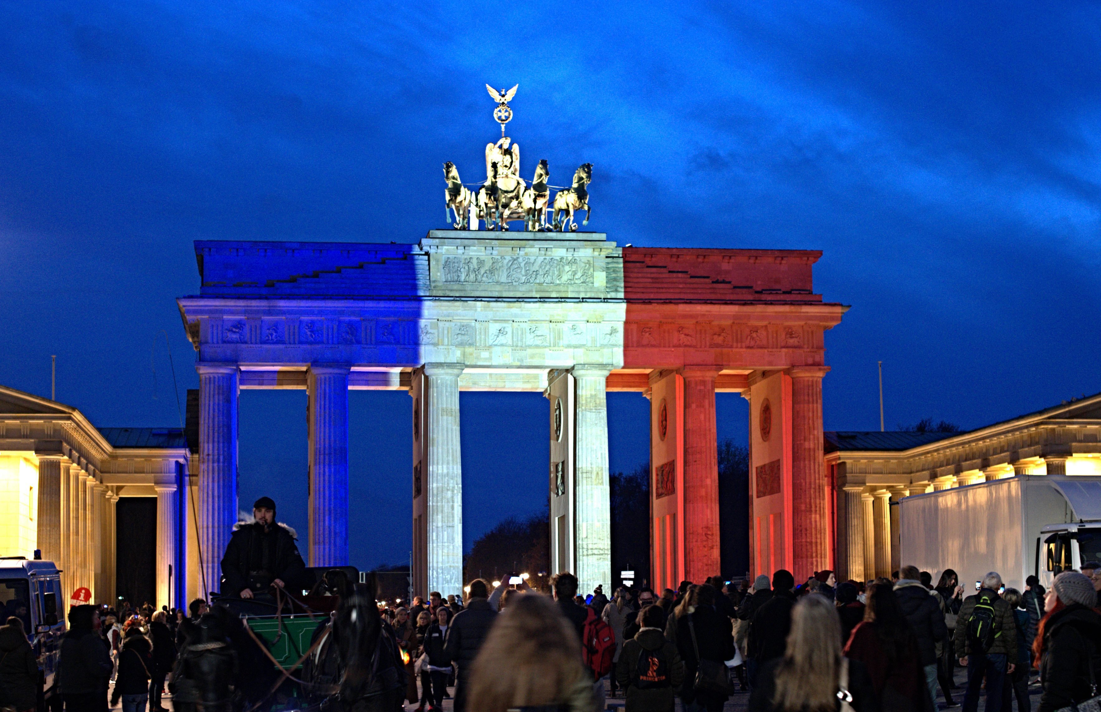 The Brandenburg Gate is illuminated in the French national colours in tribute for the victims of the Paris attacks in Berlin Nov. 14, 2015.