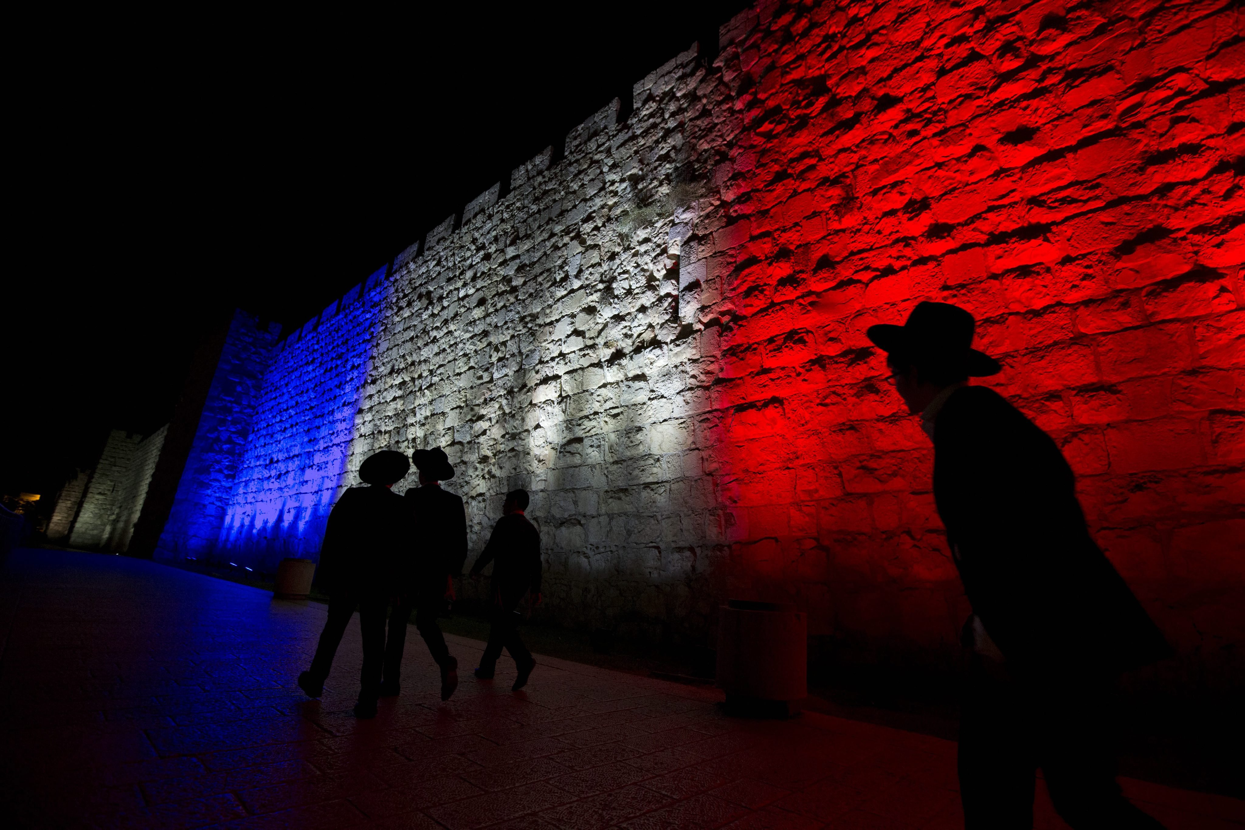 Jerusalem's Old City walls illuminated in the colors of the French national flag in solidarity for the victims of the Paris attacks, in Jerusalem on Nov. 15, 2015.