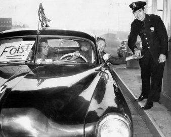 May 25, 1950: Cop grins broadly as driver of one of the first cars to enter the Brooklyn end of the Brooklyn Battery Tunnel hands him his ticket.