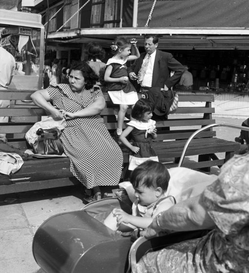 People relaxing on the sea front at Coney Island, New York.