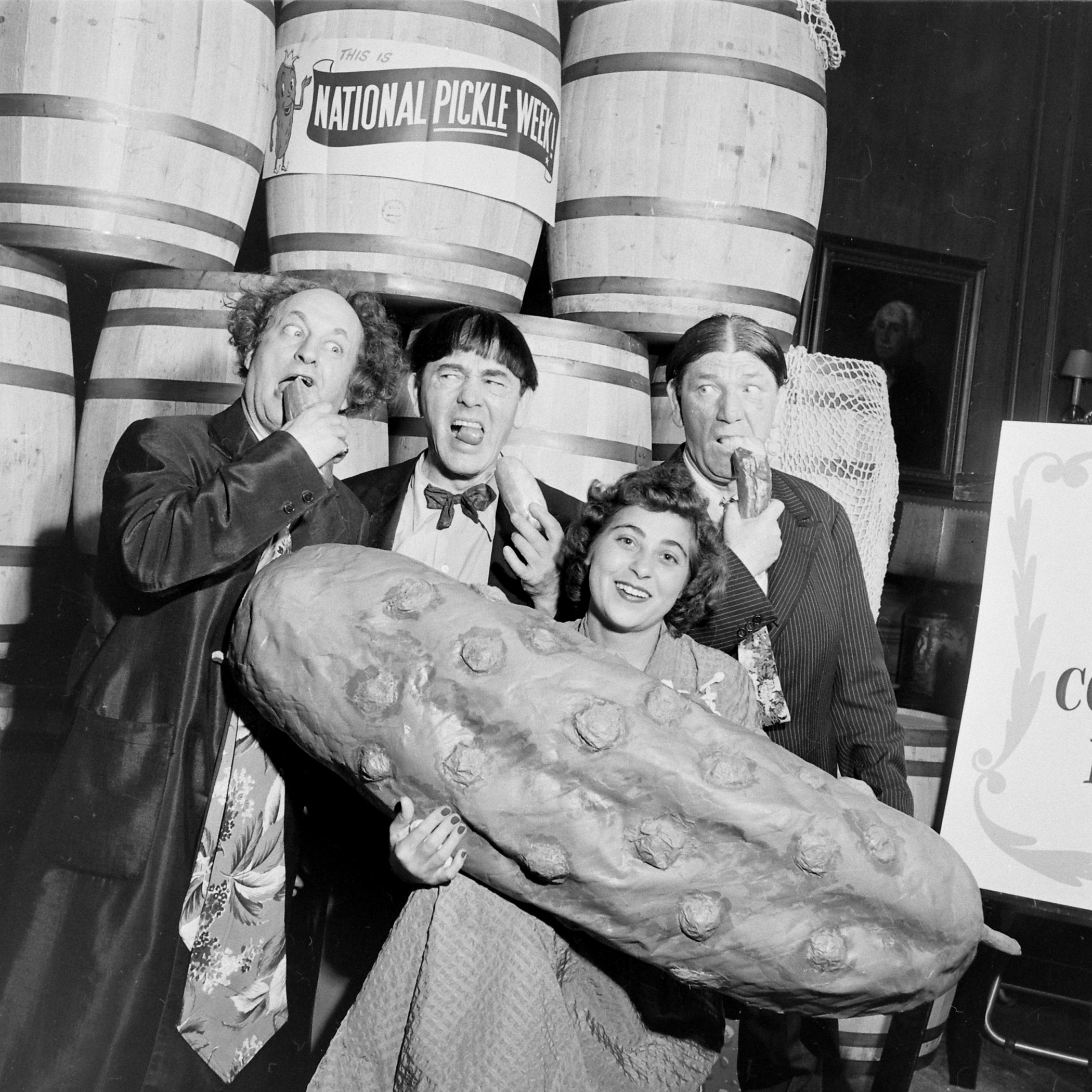The Pickle Queen poses with the Three Stooges during National Pickle Week, 1949.