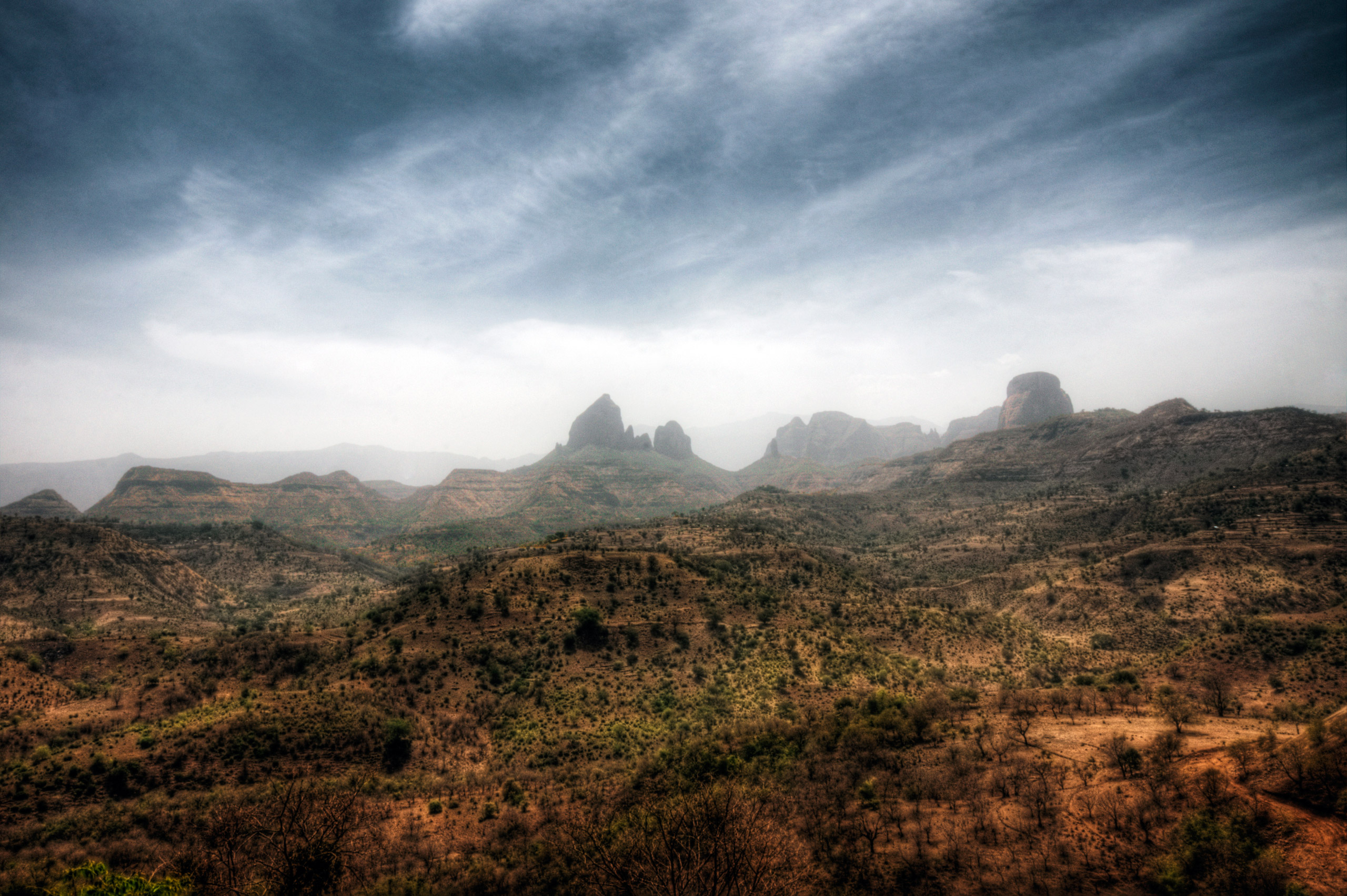 Semien mountains National Park with arid plateaux separated by valleys and rising to pinnacles, in Ethiopia.