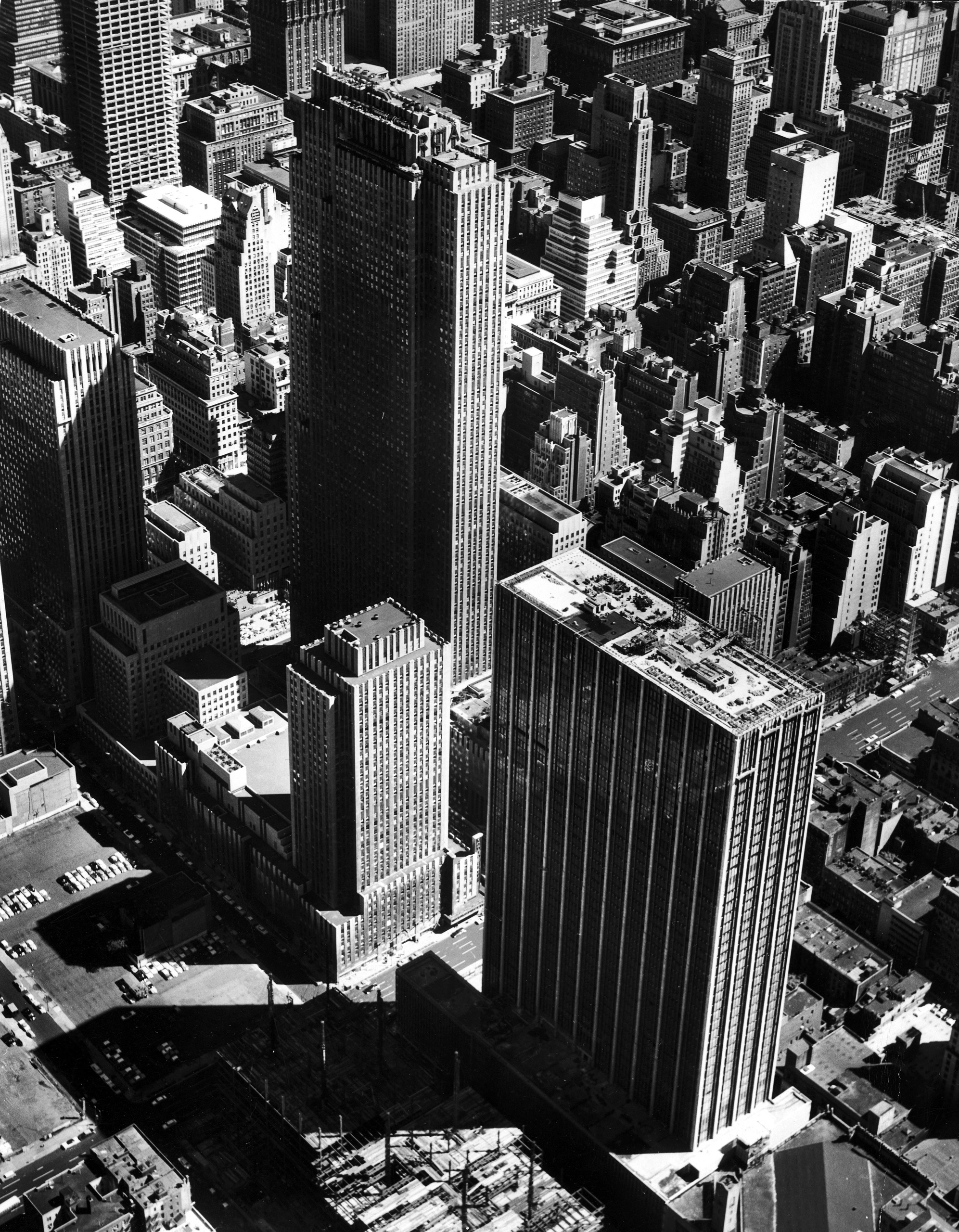 Aerial view of the Rockefeller Center complex of buildings, at the center of which is the tallest, the RCA Building. In the foreground is the nearly completed Time-Life Building (1959, Harrison, Abramovitz, & Harris), where the company moved after its residence in the Time & Life Building at 9 Rockefeller Plaza.