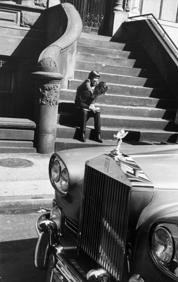 Tracy demands a piggy-back ride from her father. Sammy's Rolls-Royce is parked at the curb. This is one of his four cars—among them a Mustang and a Cadillac with bar, TV, stereo and two telephones.