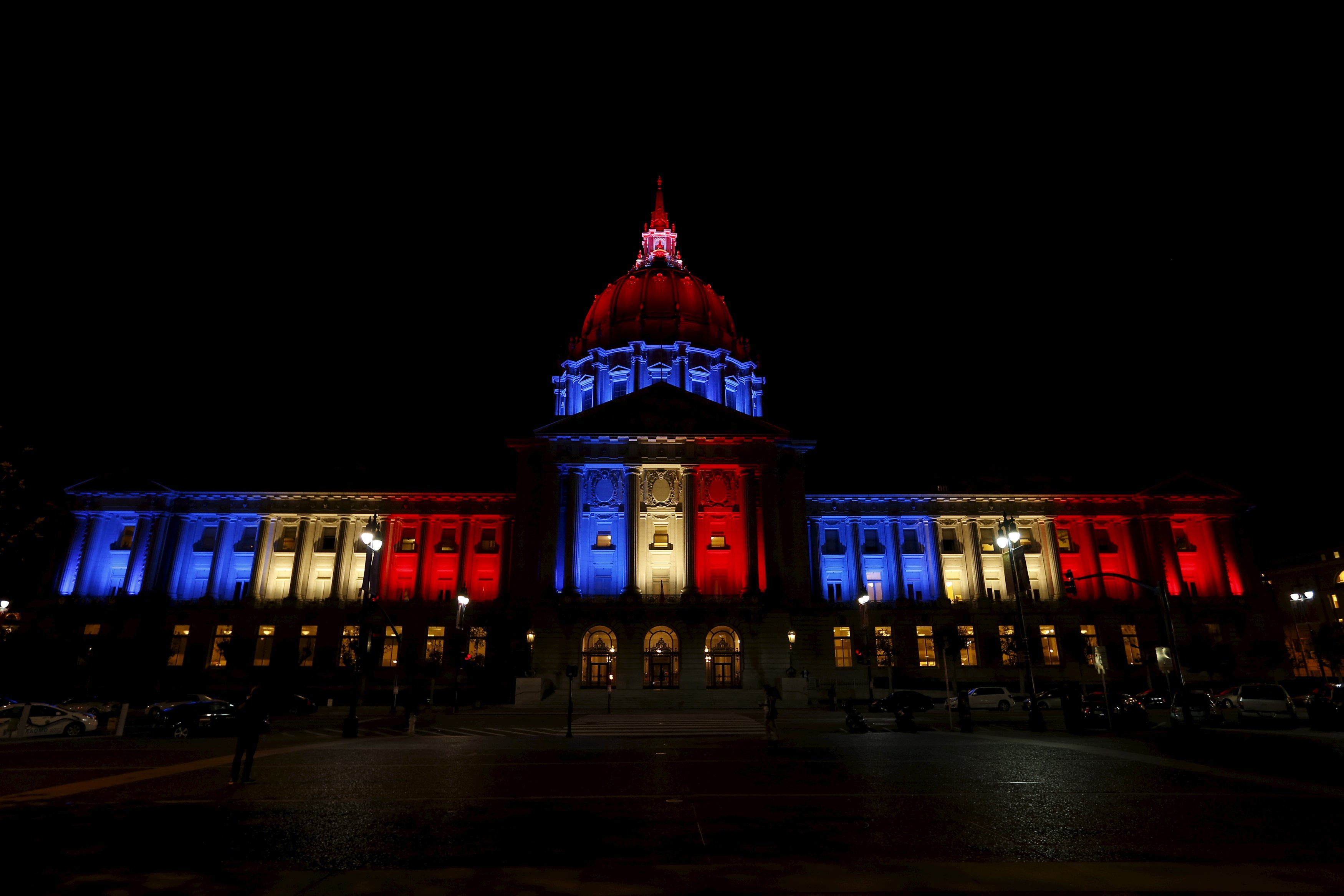 San Francisco City Hall is lit up with blue, white and red, the colors of the French flag, following the Paris terror attacks, in San Francisco, CA on Nov. 13, 2015.