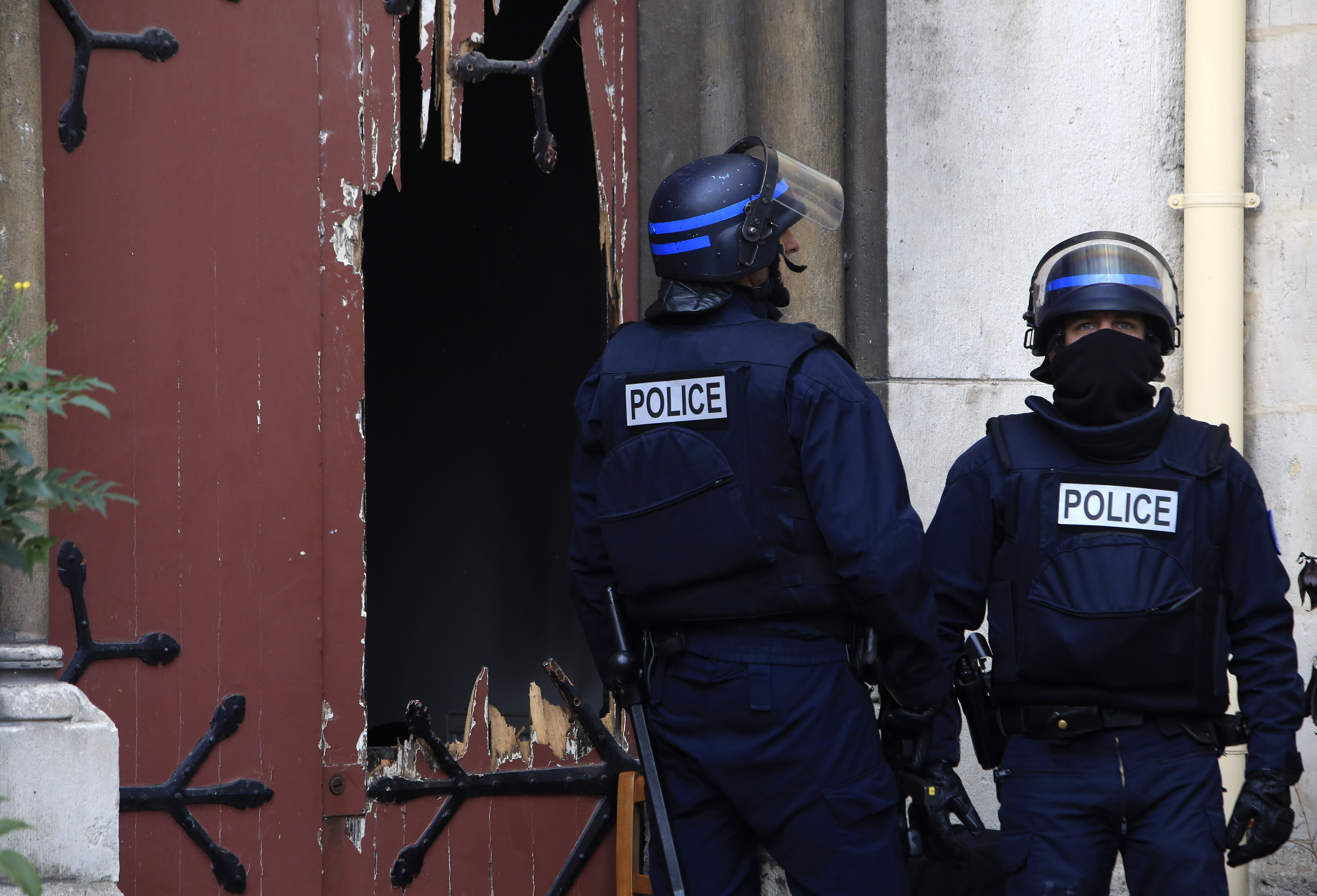 French police officer guard a church they stormed it  in Paris suburb Saint-Denis, on Nov.18, 2015.