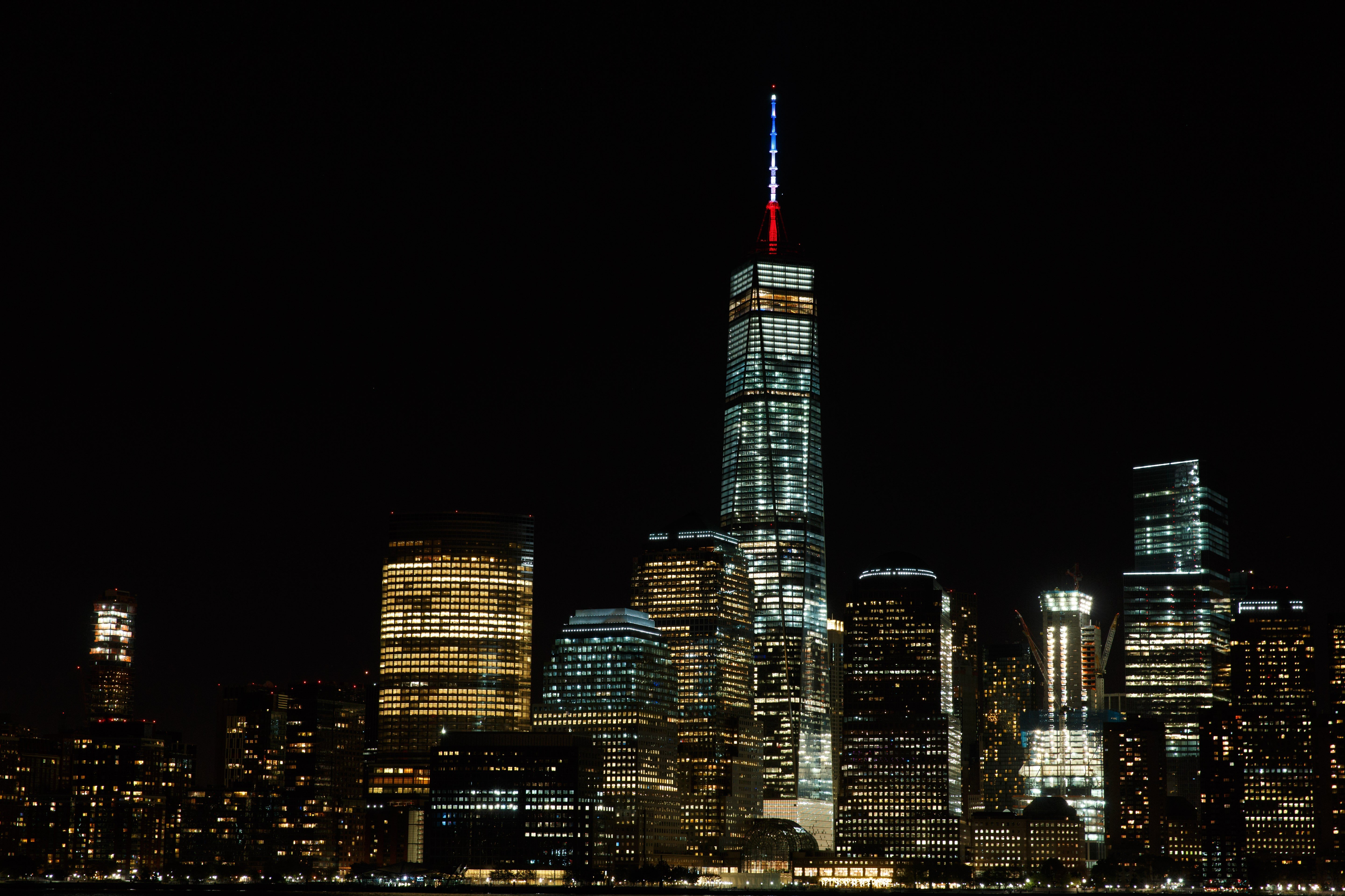 Colors that resemble the French national flag are seen on top of the tower of One World Trade Center in New York City onNov. 13, 2015.