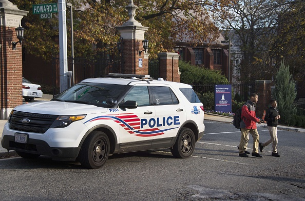 DC Metro Police patrol the front gates of Howard University in Washington, DC, on November 12, 2015, as the campus tightens security after an online death threat was issued against the historically black college.