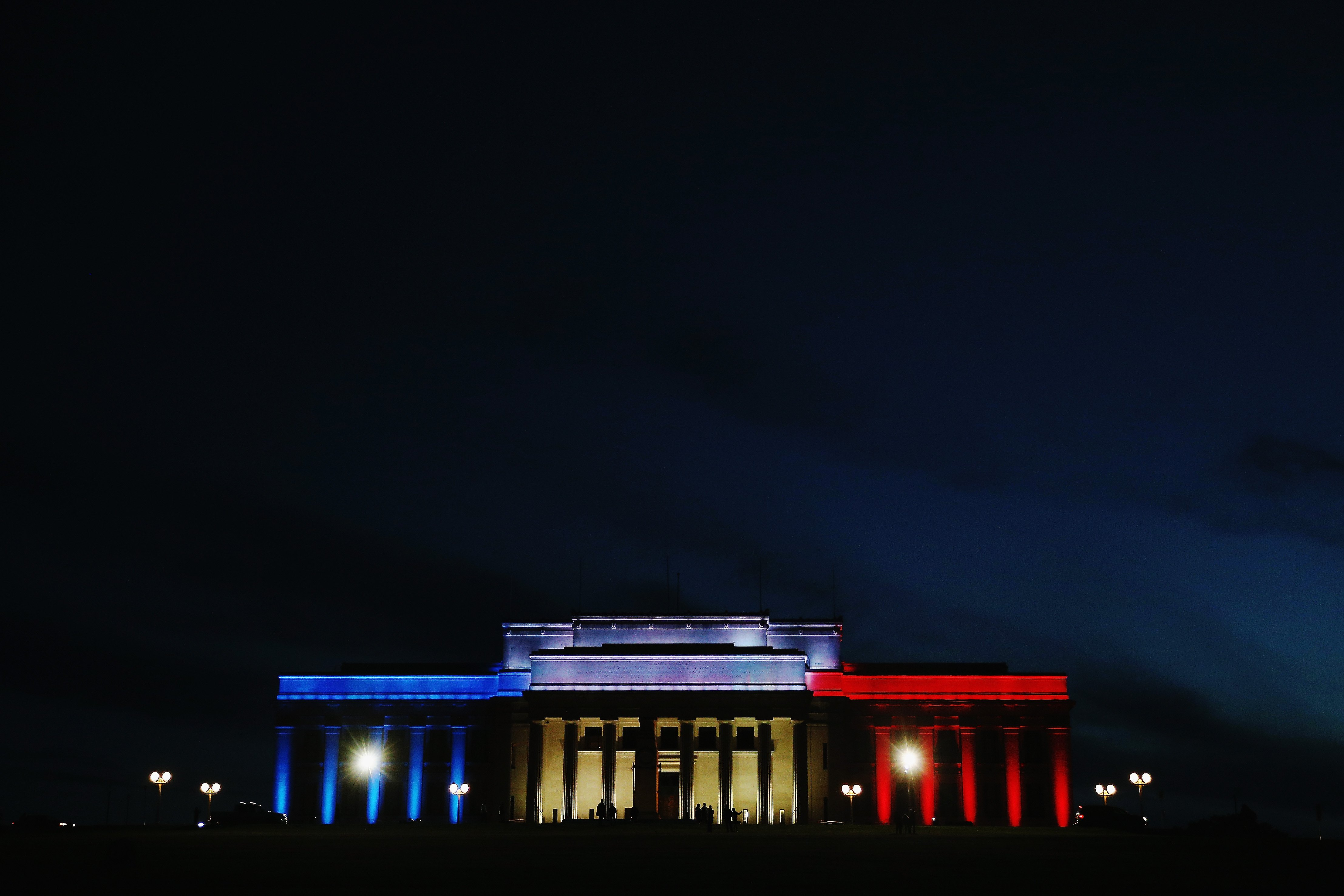 Lights in the colors of the French flag, light up the Auckland Museum to remember victims of the Paris attacks, in New Zealand on Nov. 14, 2015.