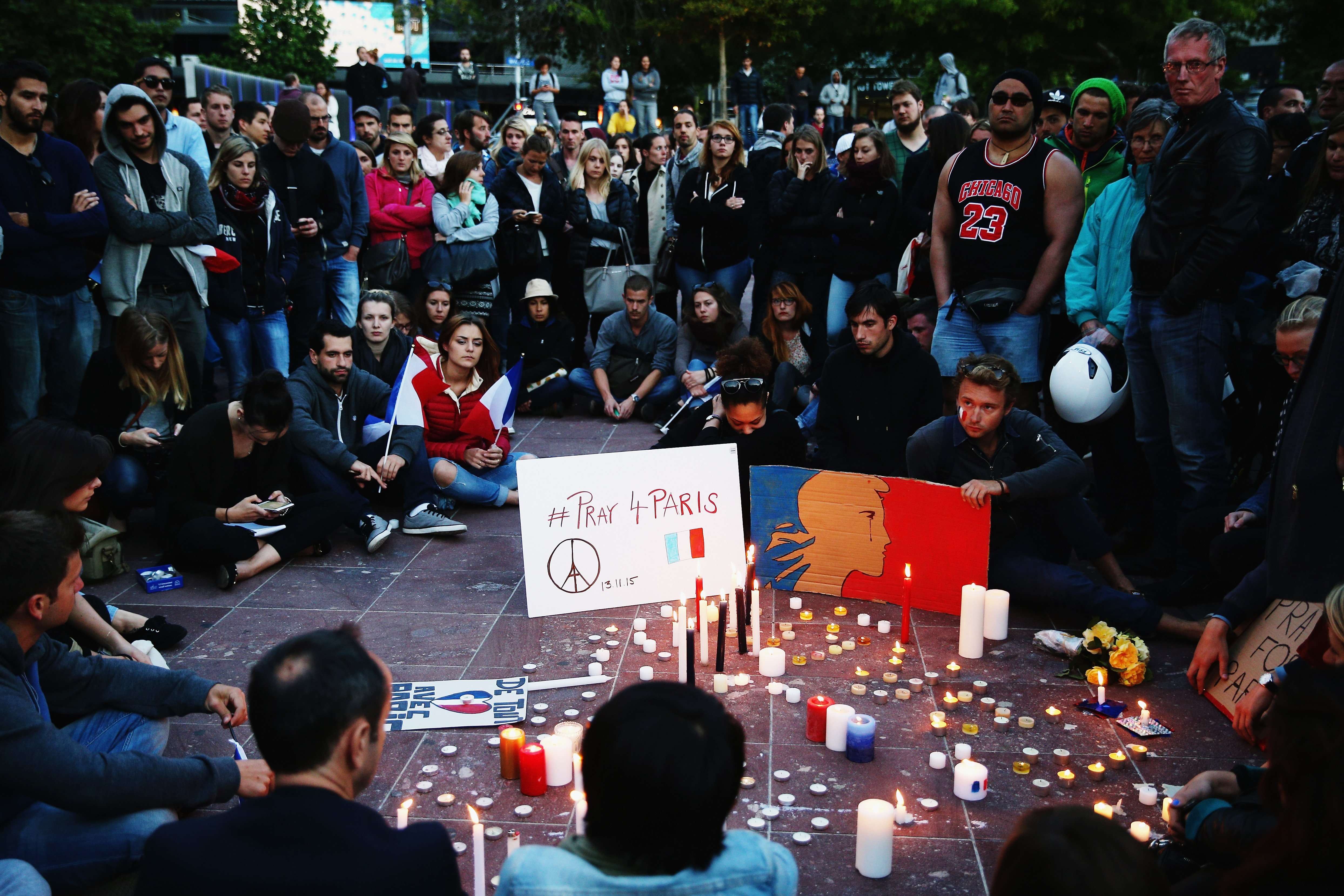 People gather during a vigil in Aotea Square in Auckland, New Zealand on Nov. 14, 2015.
