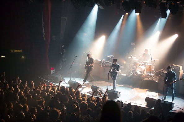 American rock group Eagles of Death Metal perform on stage on Nov. 13, 2015, at the Bataclan concert hall in Paris, few moments before four men armed with assault rifles and shouting  Allahu akbar  ( God is great! ) stormed into the venue