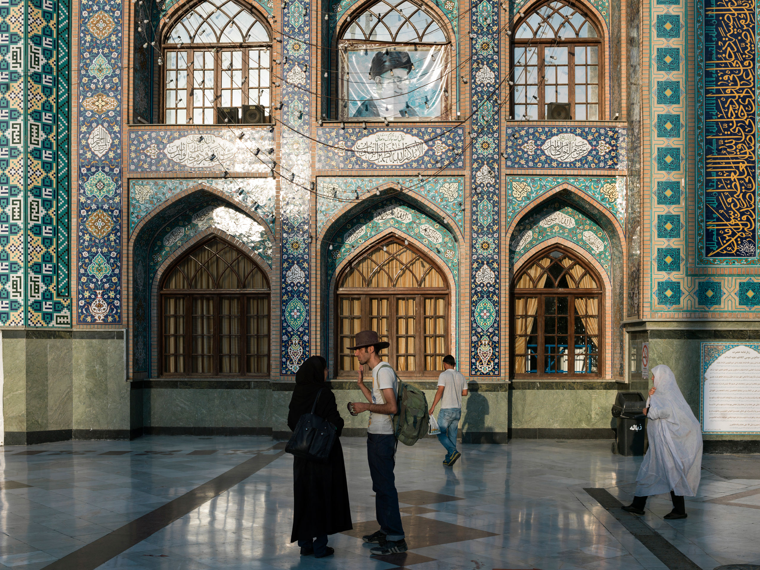 A young couple stand in front of the shrine Imāmzādeh Sāleh, located in Tehran's most northern square, Tajrish, in the Shemiran district.