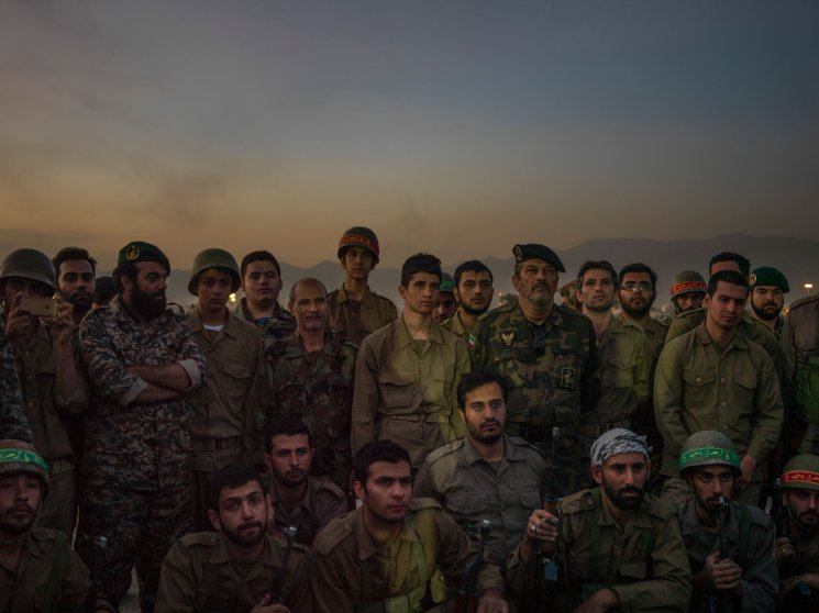 A battalion of members of the Iranian paramilitary Baseej force pose for a picture with a high revolutionary Guards Corps General, after having participated in a reenactment of the Iran-Iraq (1980-1988) war in the South of Tehran.