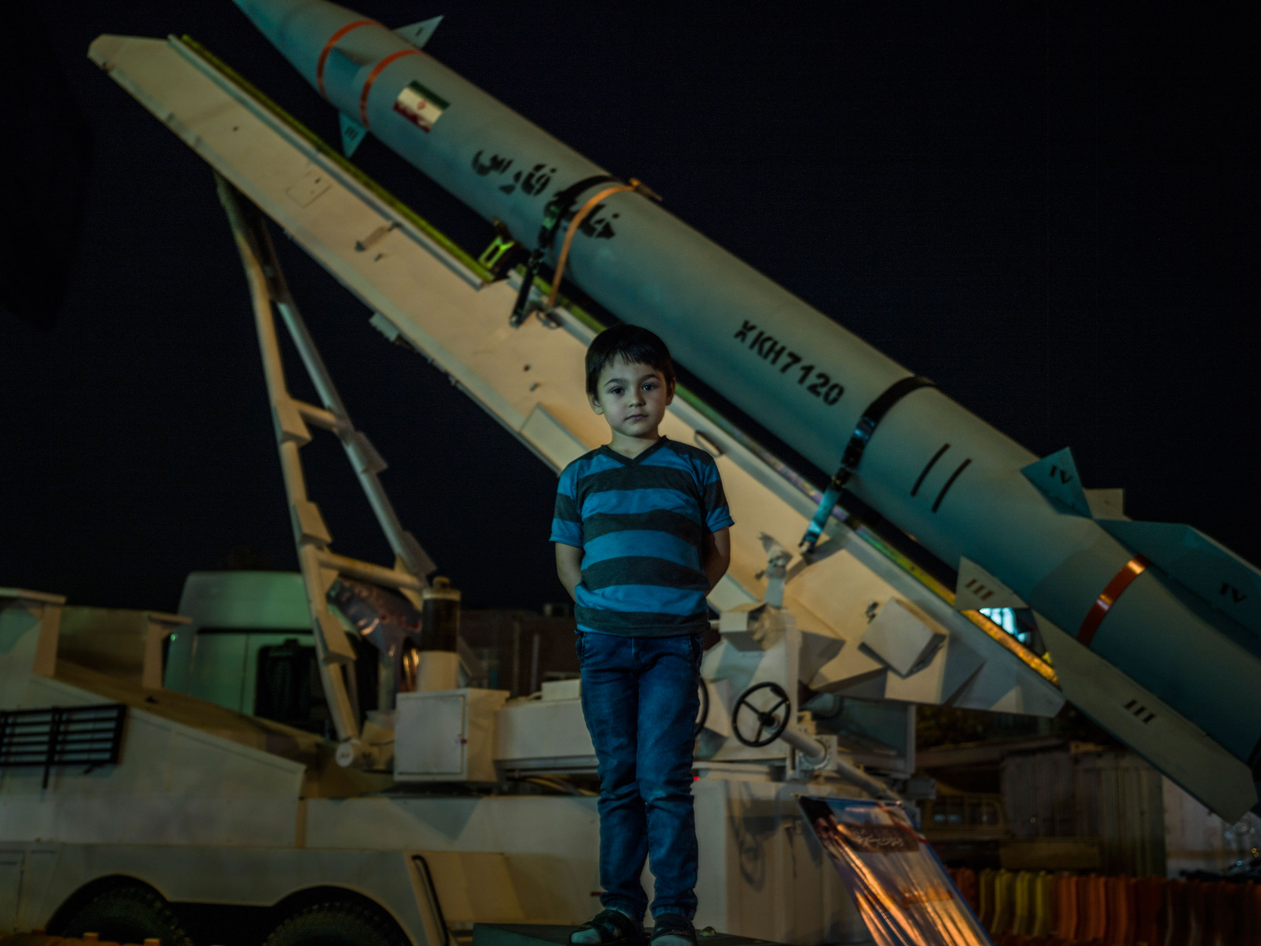 A boy visits Tehran's southern Baharestan Square with his family, where a missile is displayed as part of the  Sacred Defense Week,  a period commemorating the Iran-Iraq War.