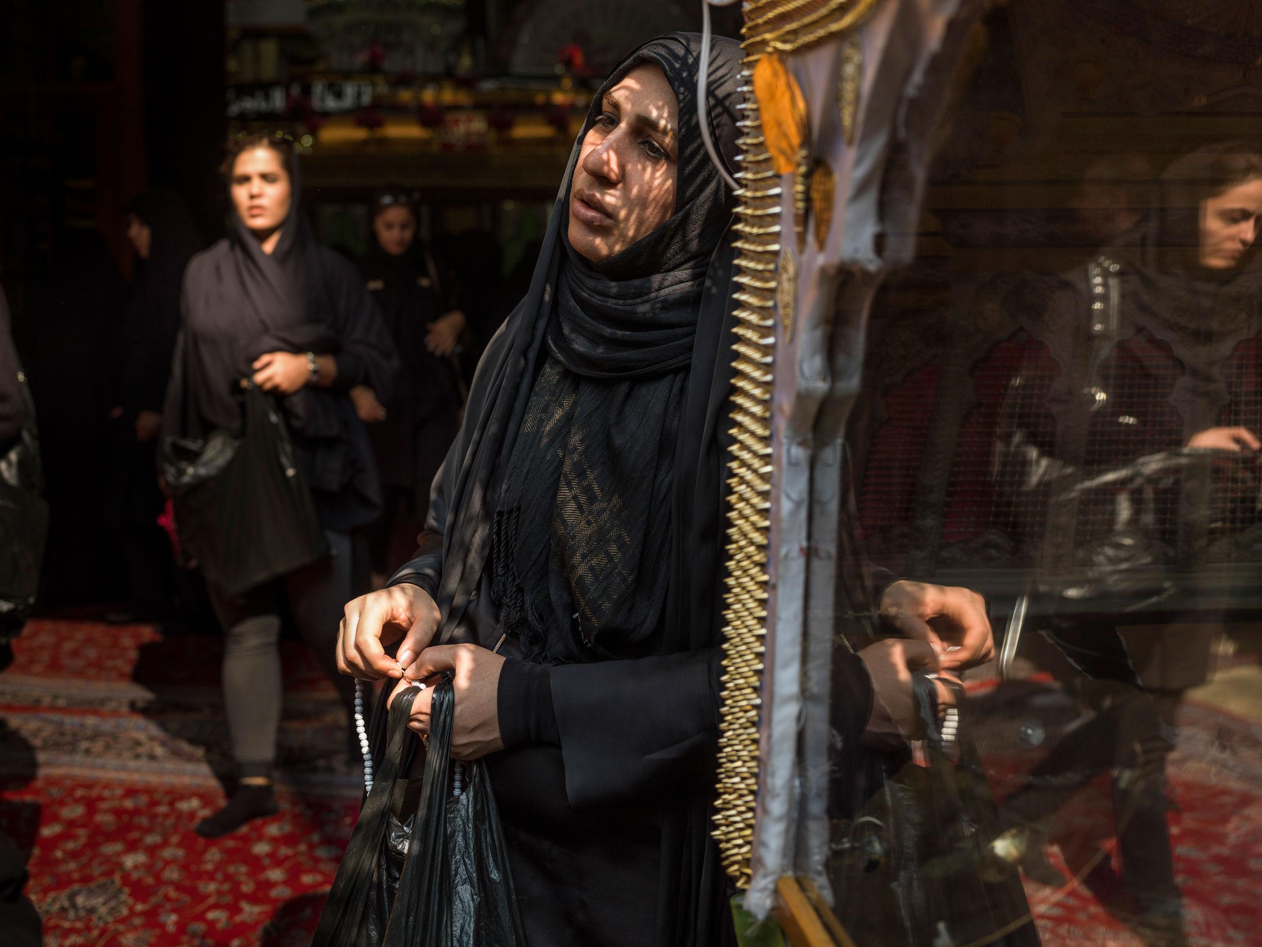 Iranian women listen to a religious speech in a mosque.