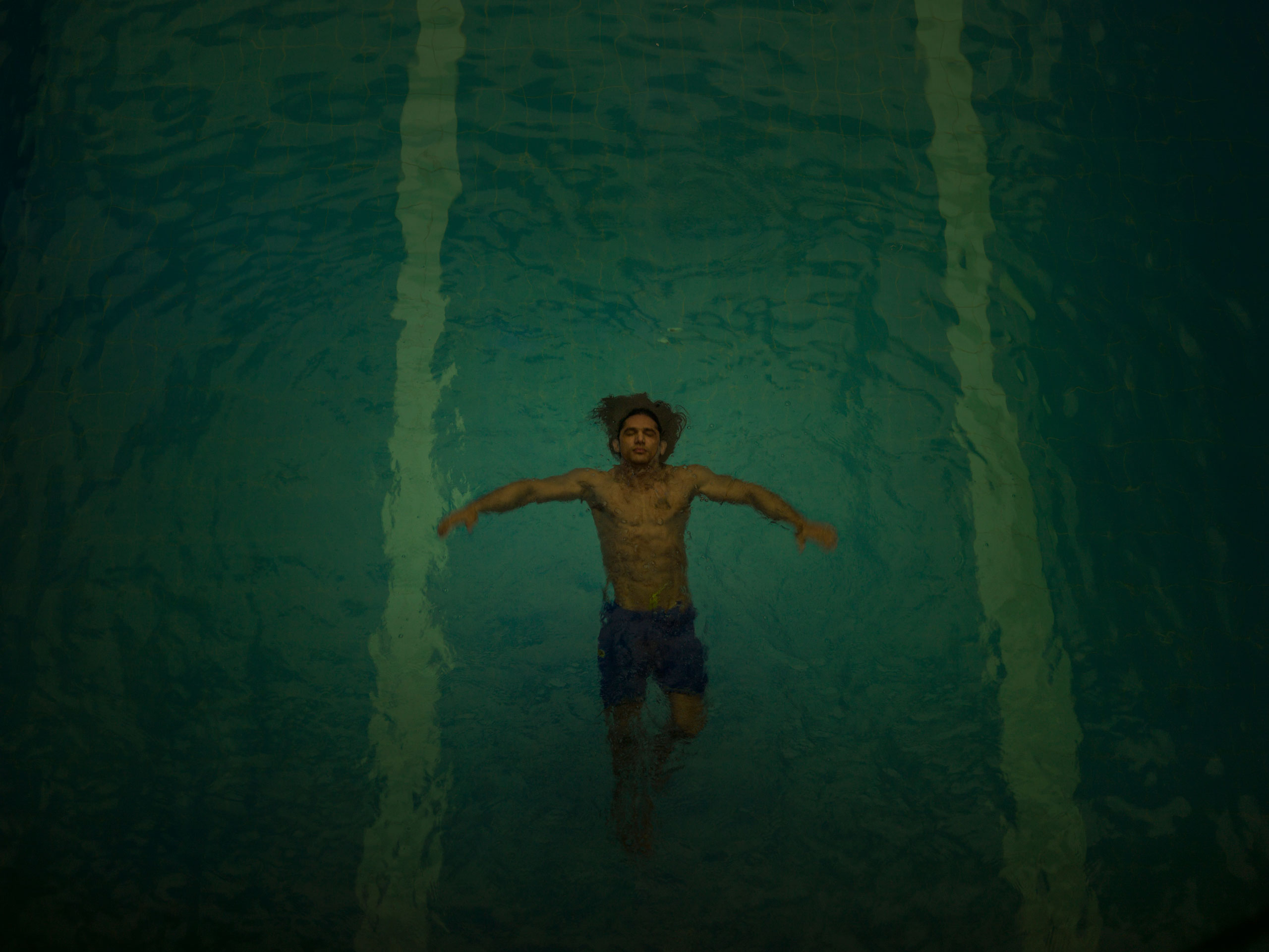 Arash Fayazi swims in the pool of the Royal Oxygen Sports Club. Fazeli is a body building champion and regularly exercises at the pool.