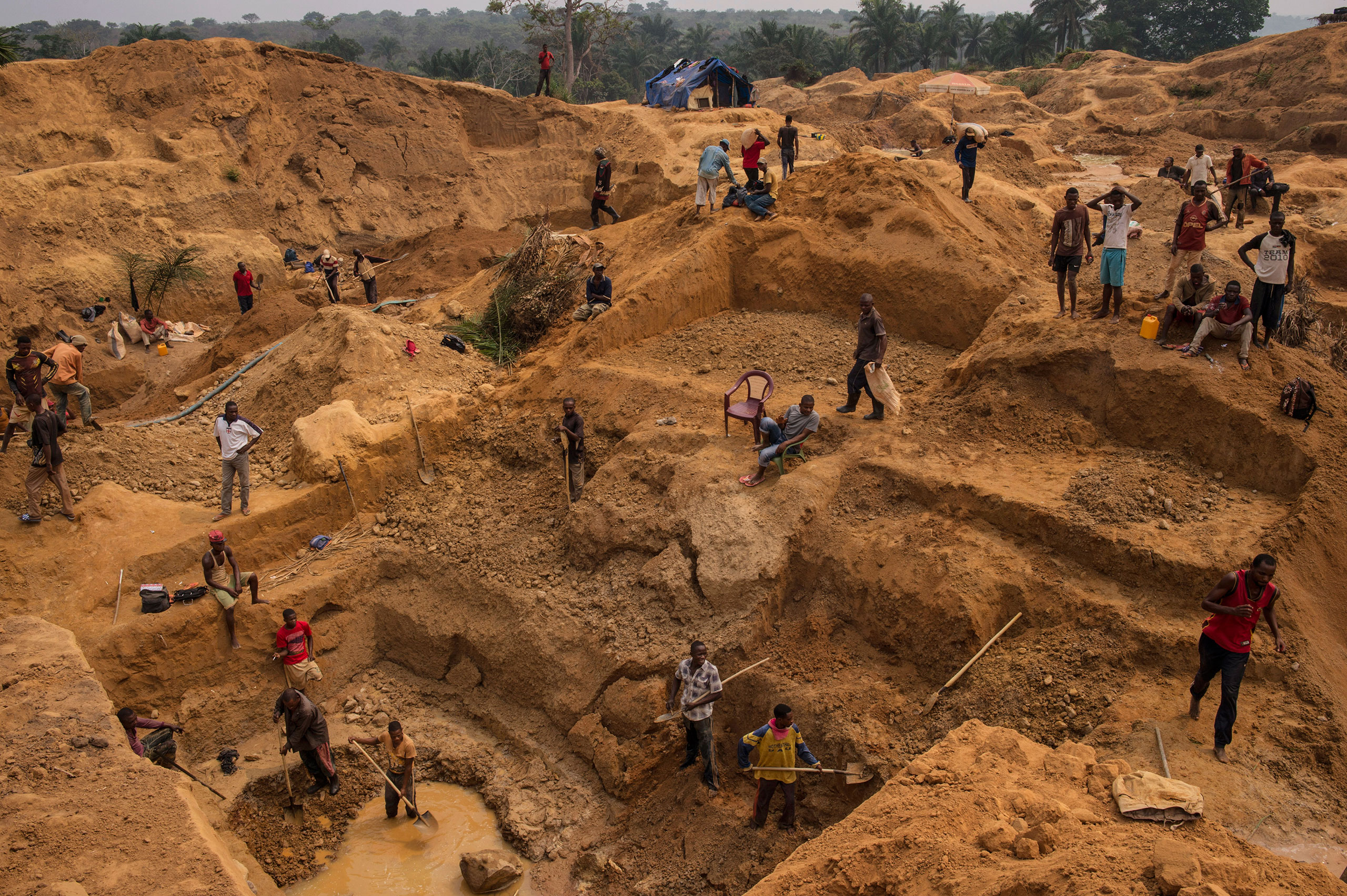 Congolese workers search for rough diamonds Kangambala mine in Lunged, in the south west region of Kasai in the Democratic Republic of Congo, the heart of the diamond mining area in the DRC, August 9, 2015.From  Inside the Democratic Republic of Congo's Diamond Mines