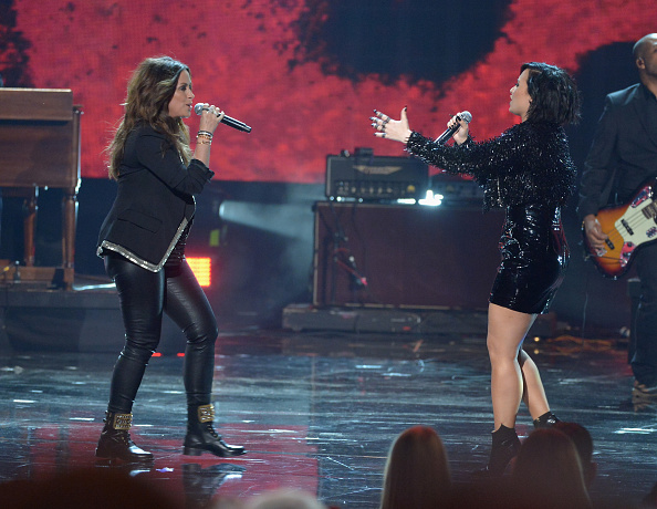 Alanis Morissette and Demi Lovato perform onstage during the 2015 American Music Awards at Microsoft Theater in Los Angeles on Nov. 22, 2015.